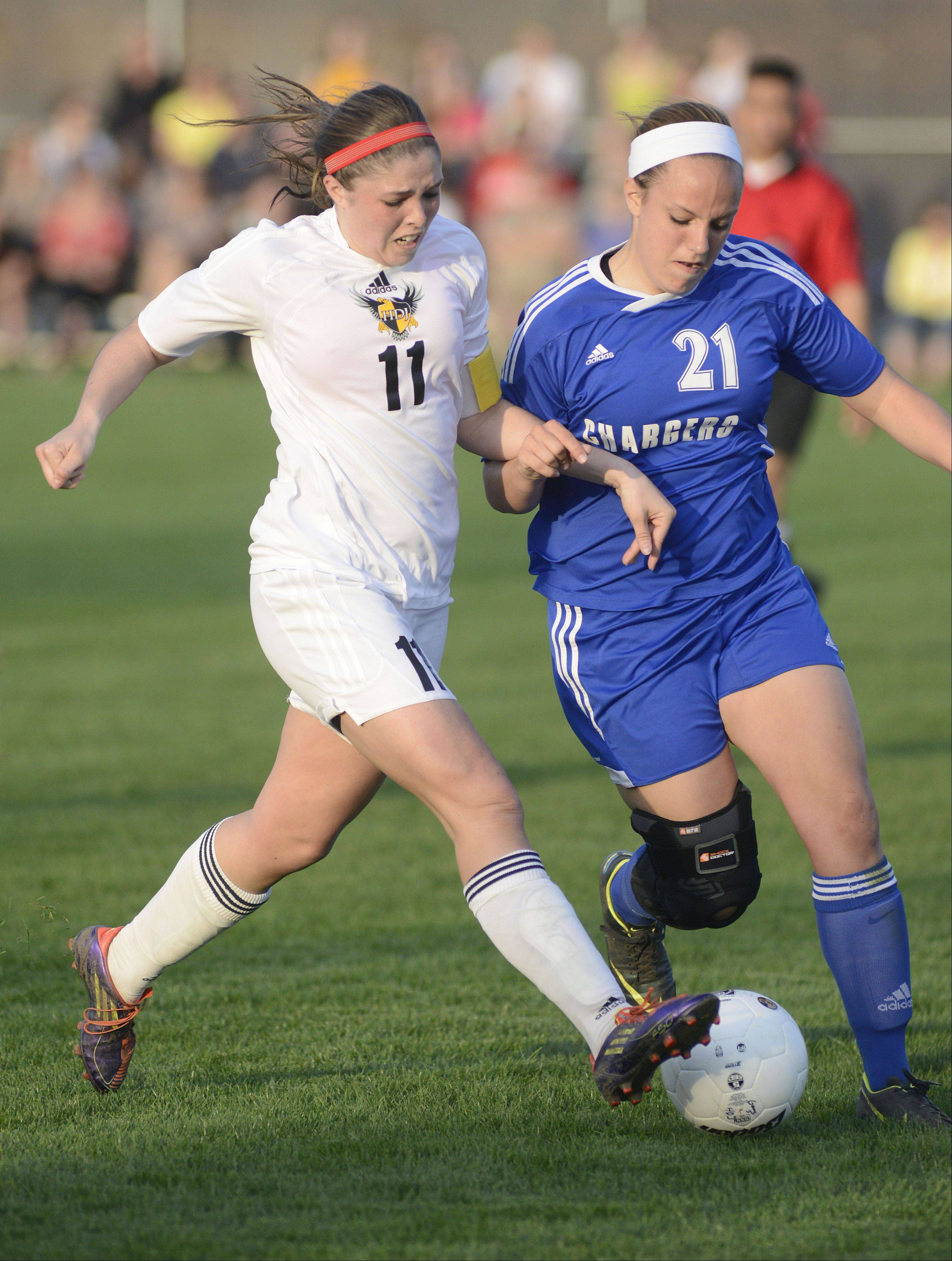 Jacobs' Margaret Rivera and Dundee-Crown's Brittney Gantz fight for the ball in the first half on Tuesday at Jacobs.