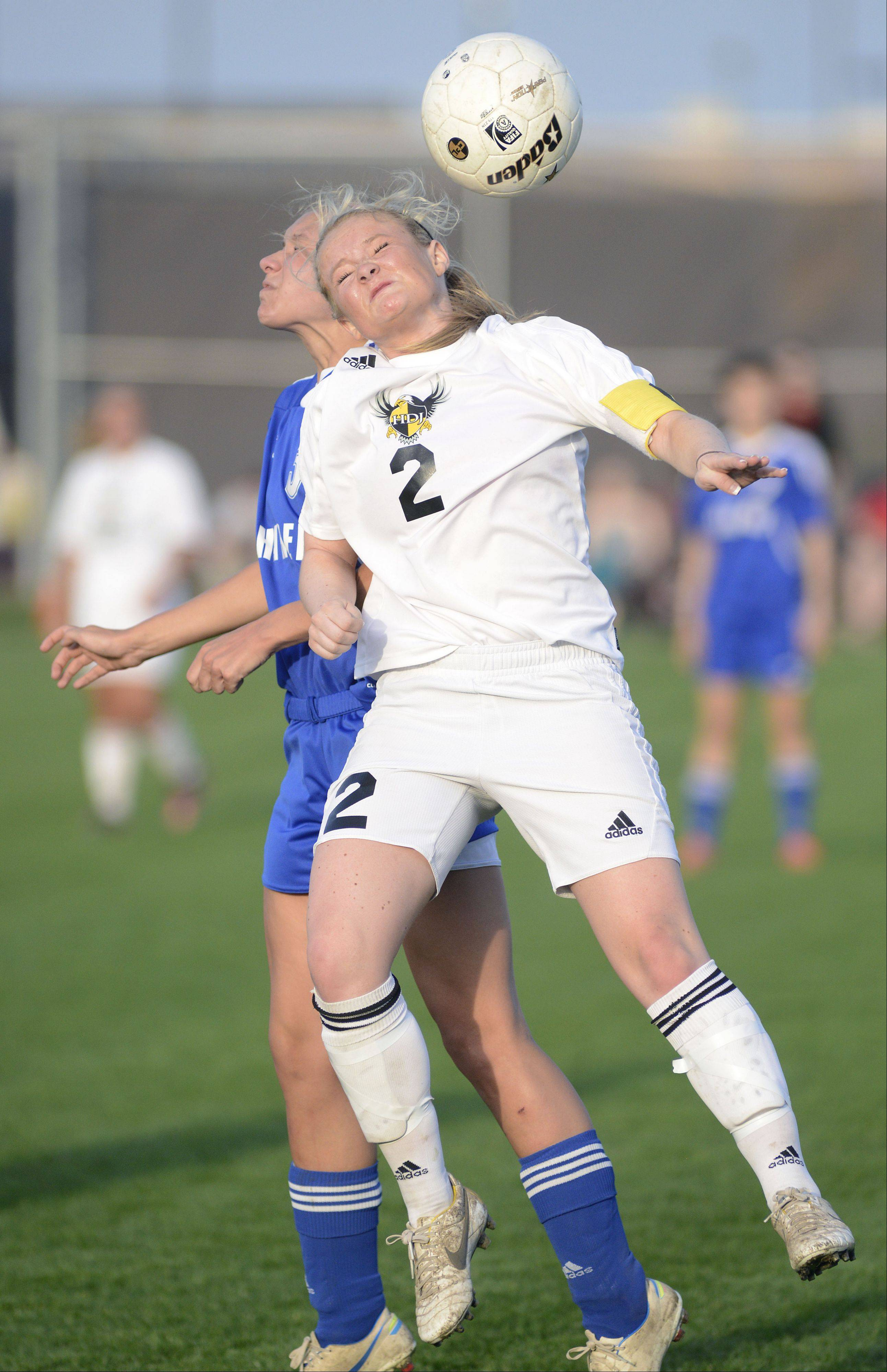 Dundee-Crown's Payton De Luga and Jacobs' Kylie Dennison head the ball in the first half on Tuesday.