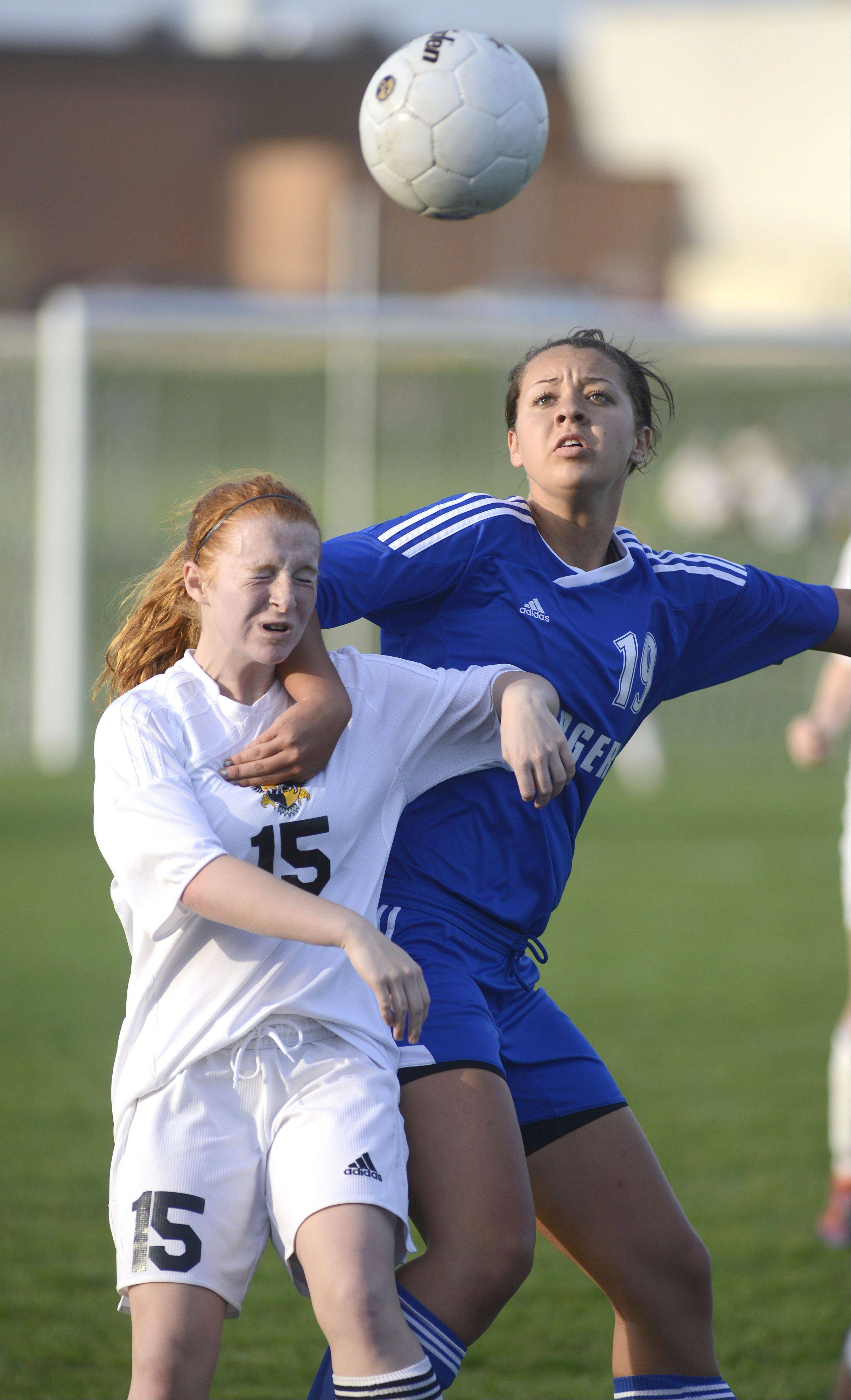 Jacobs' Allie Gold is pushed off by Dundee-Crown's Ashley Raby as they battle for the ball in the first half on Tuesday.