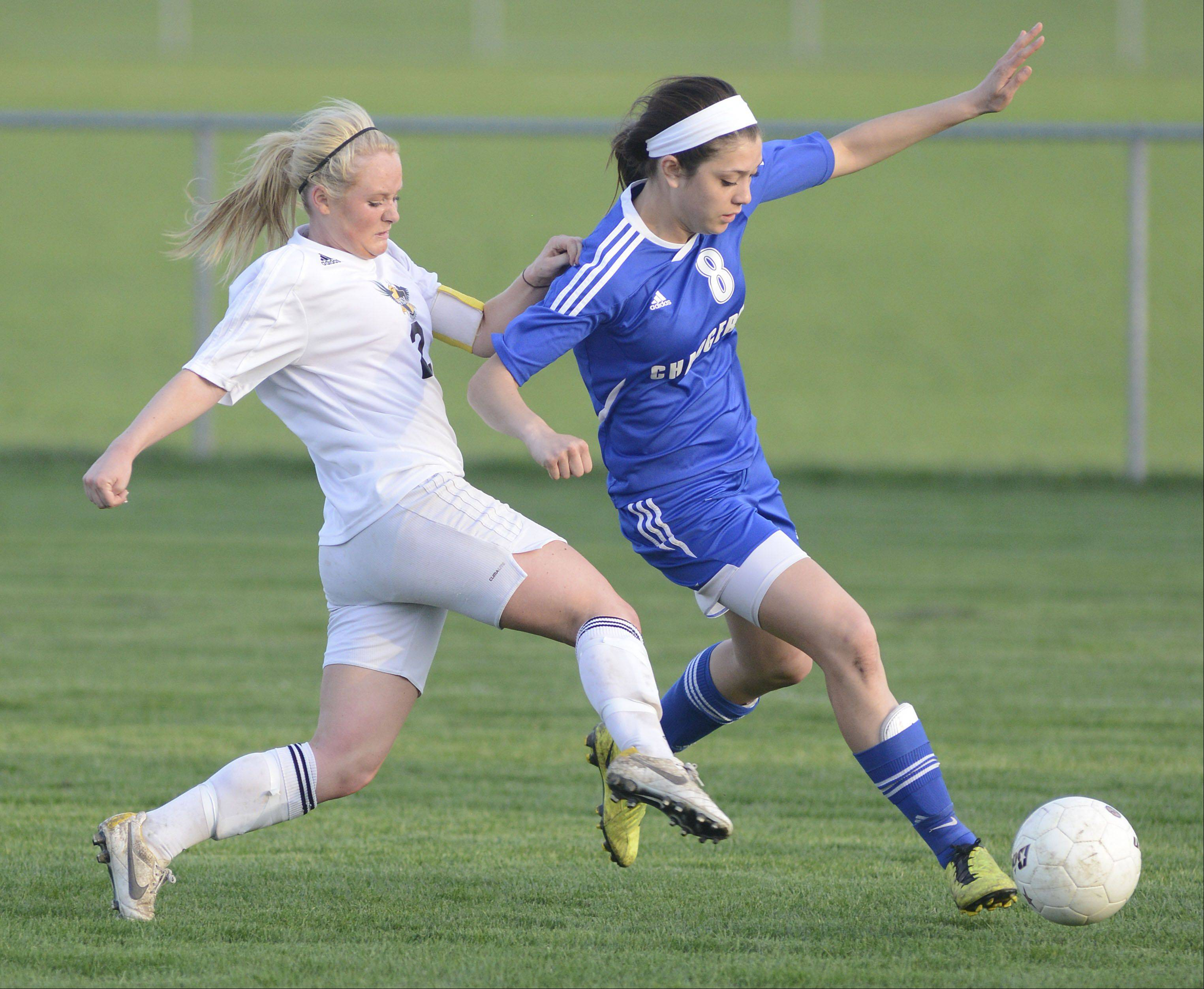 Jacobs' Kylie Dennison and Dundee-Crown's Jordan Fryer compete for the ball in the first half on Tuesday.