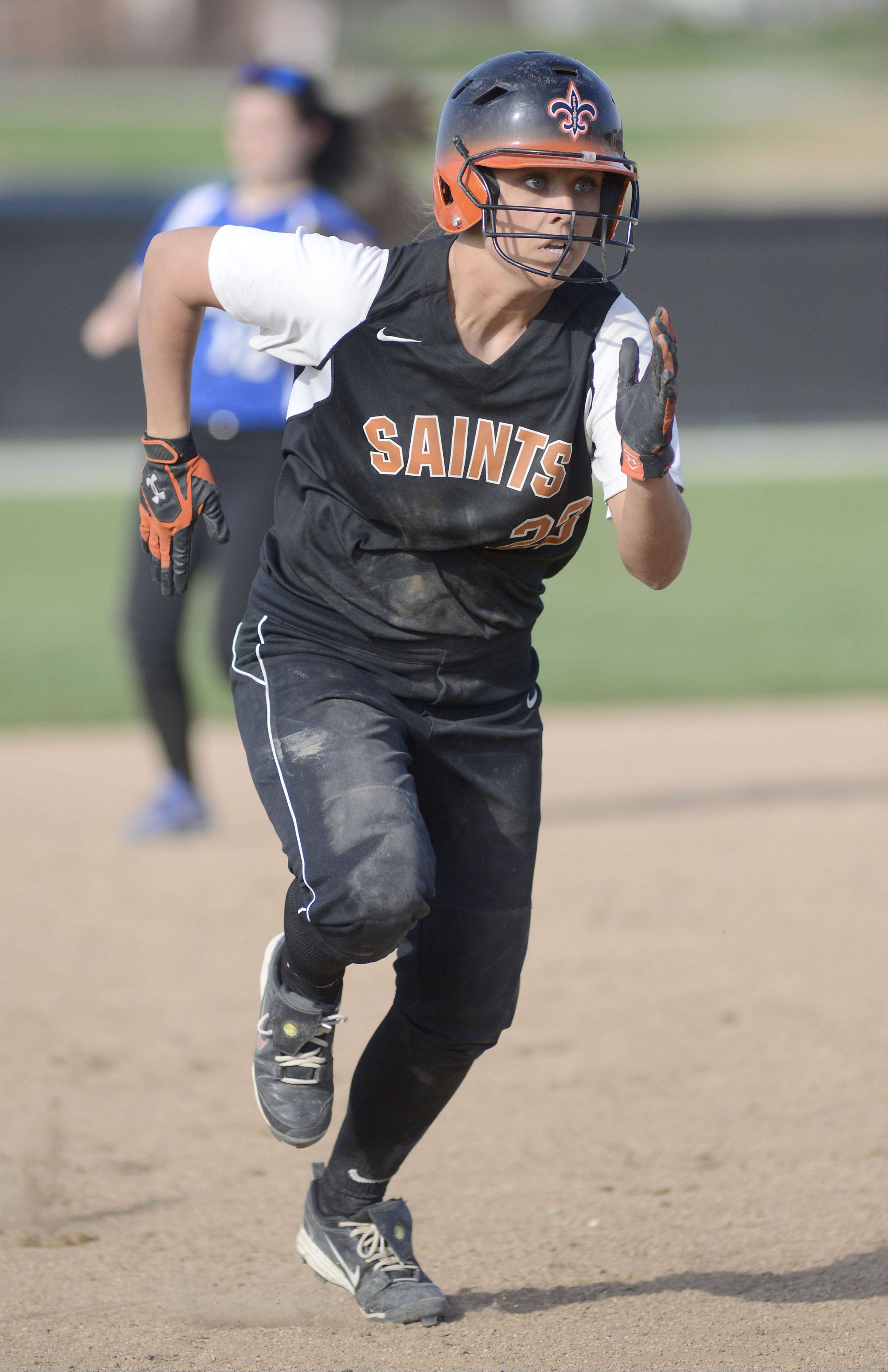 St. Charles East Mackenzie Meadows sprints for third base in the fourth inning on Tuesday, April 30.