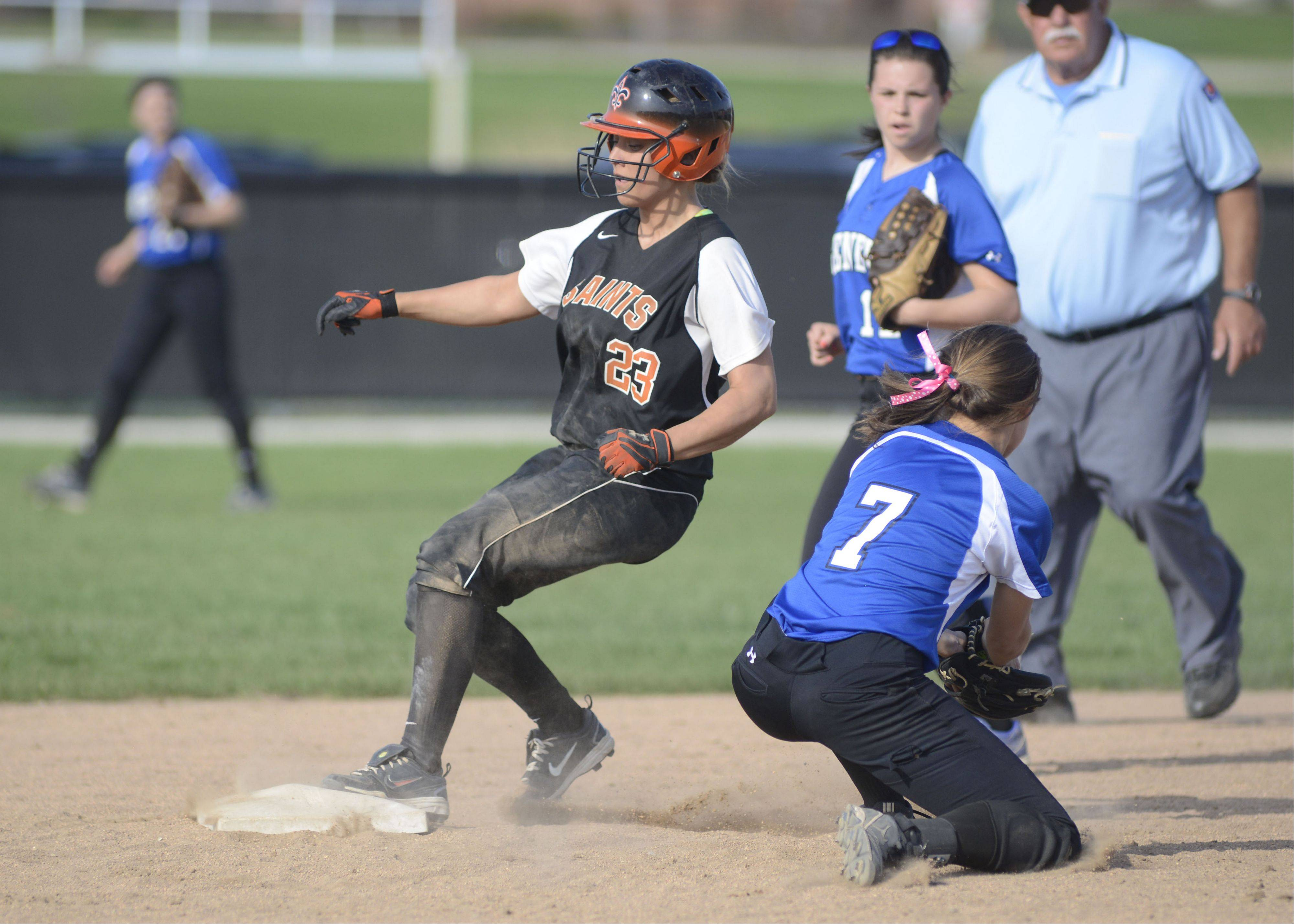 St. Charles East's Mackenzie Meadows makes it to second base before the ball hits Geneva's Anna Geary's glove in the fourth inning on Tuesday, April 30.