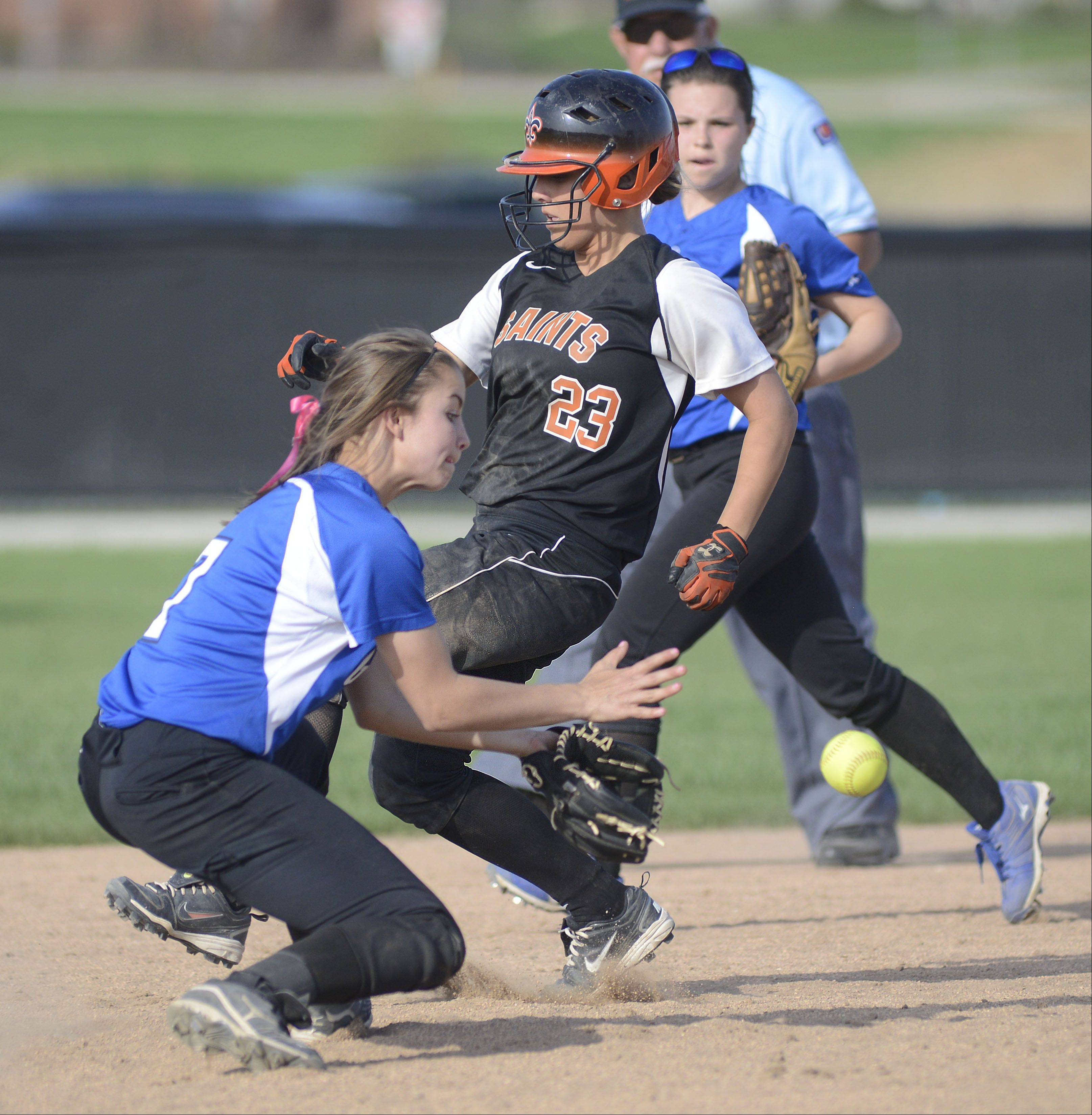 St. Charles East's Mackenzie Meadows beats the ball to Geneva's Anna Geary's glove in the fourth inning on Tuesday, April 30.