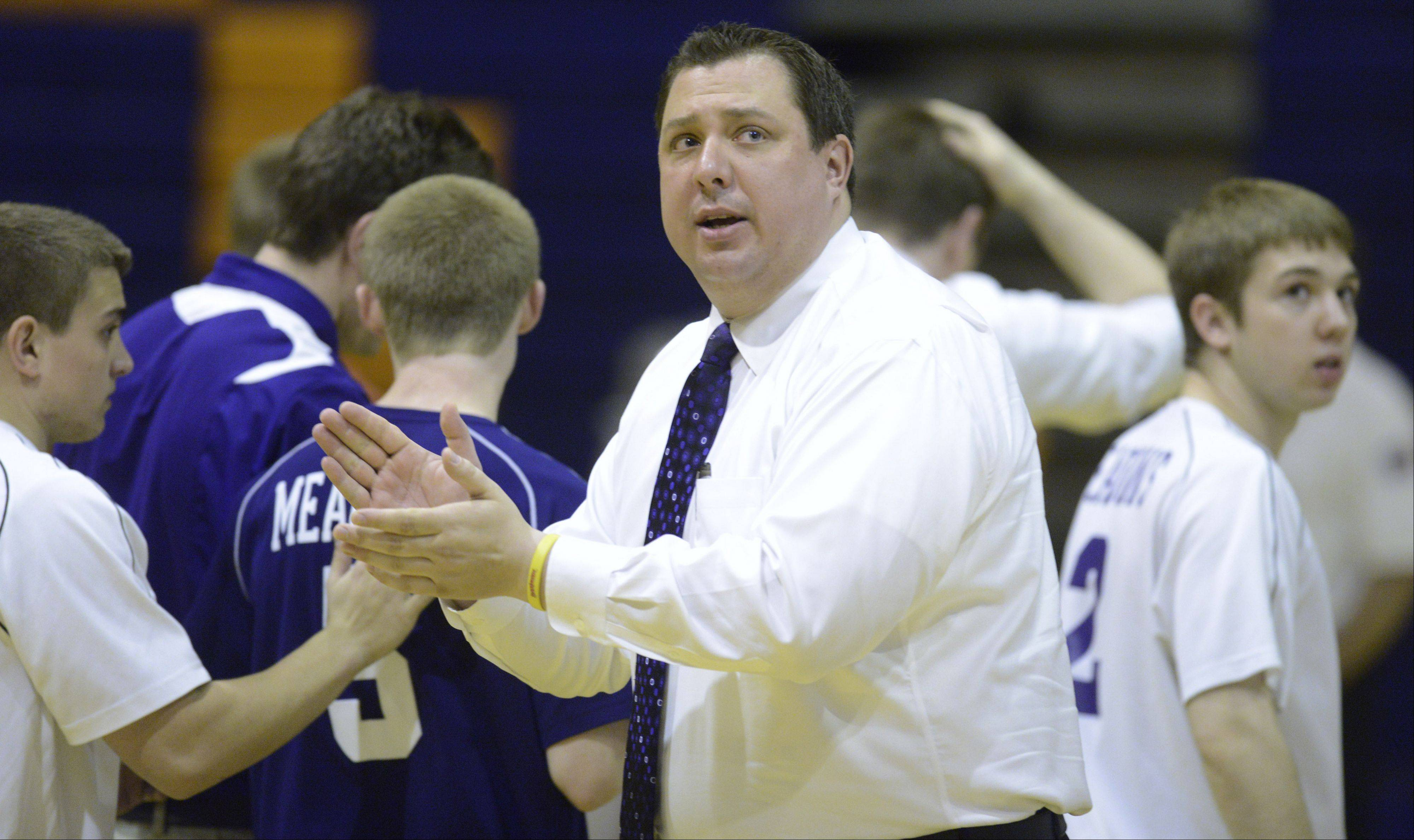 Rolling Meadows boys volleyball coach Tim Piatek leads his team during Tuesday's match at Buffalo Grove.