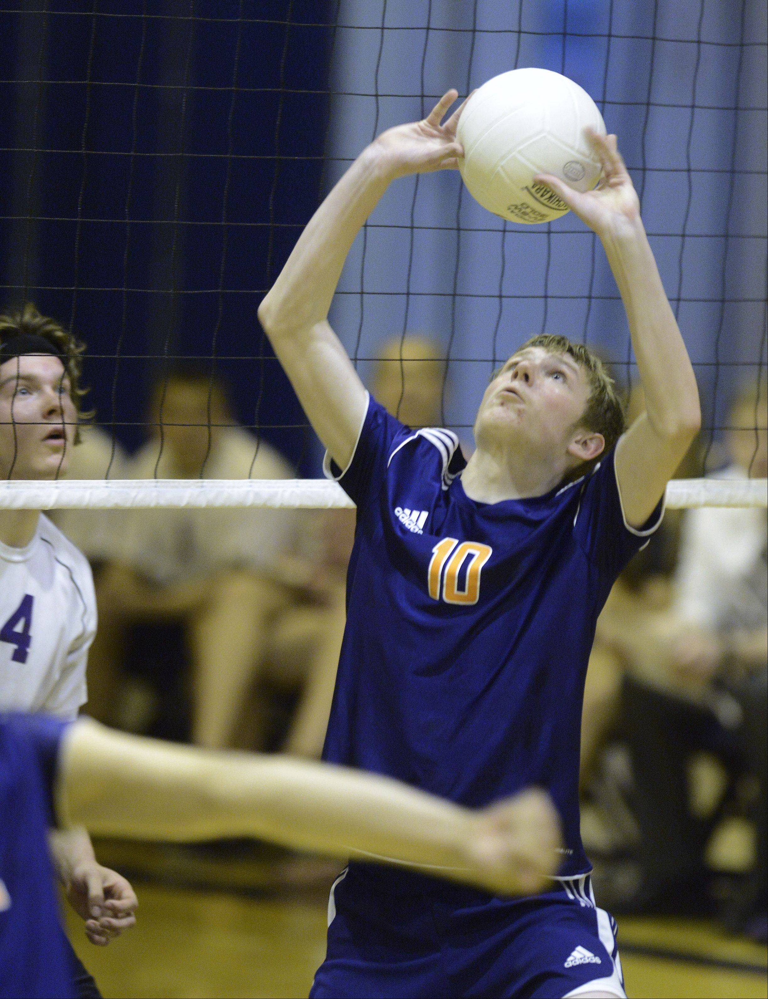 Buffalo Grove's Kevin Shanahan sets the ball during Tuesday's match against Rolling Meadows.