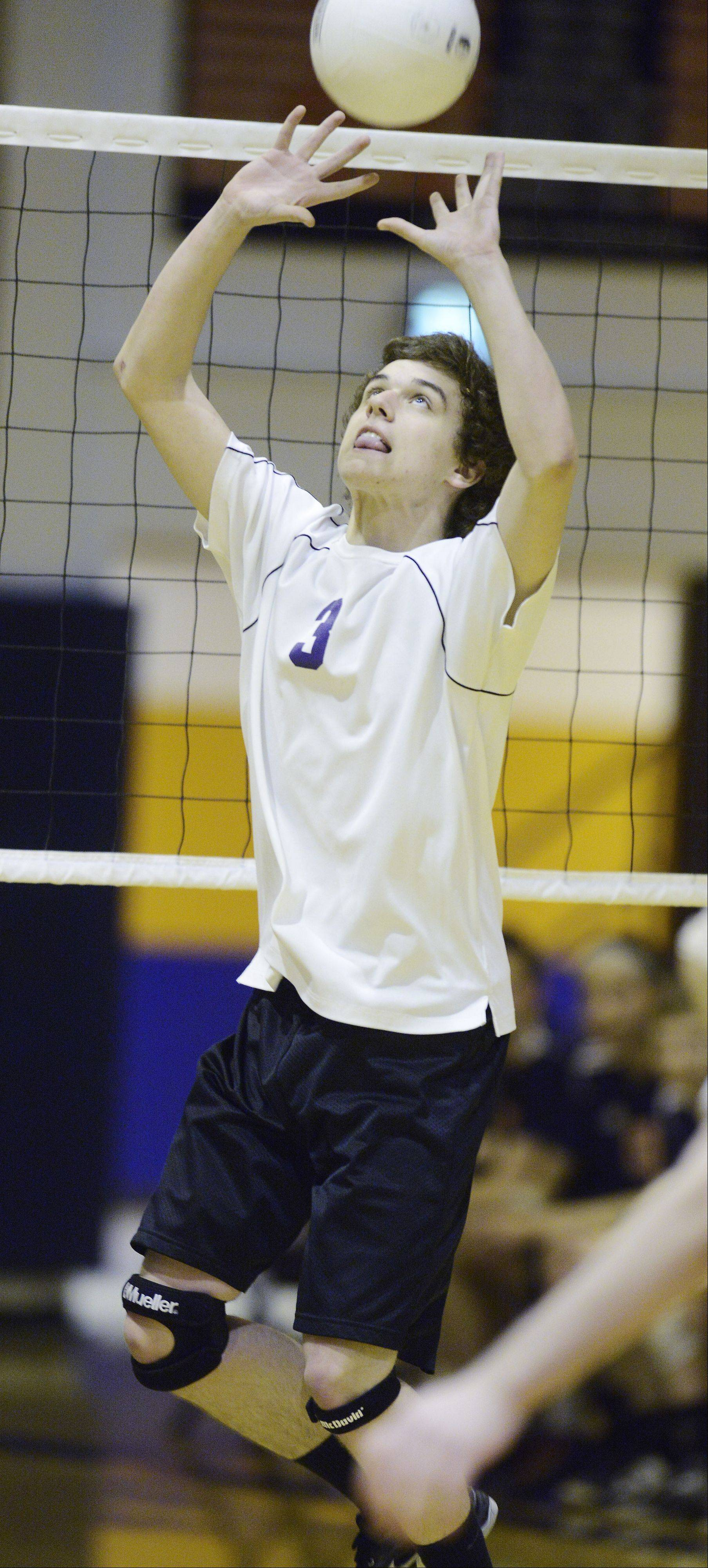 Rolling Meadows' Brett Frey sets the ball during Tuesday's match at Buffalo Grove.