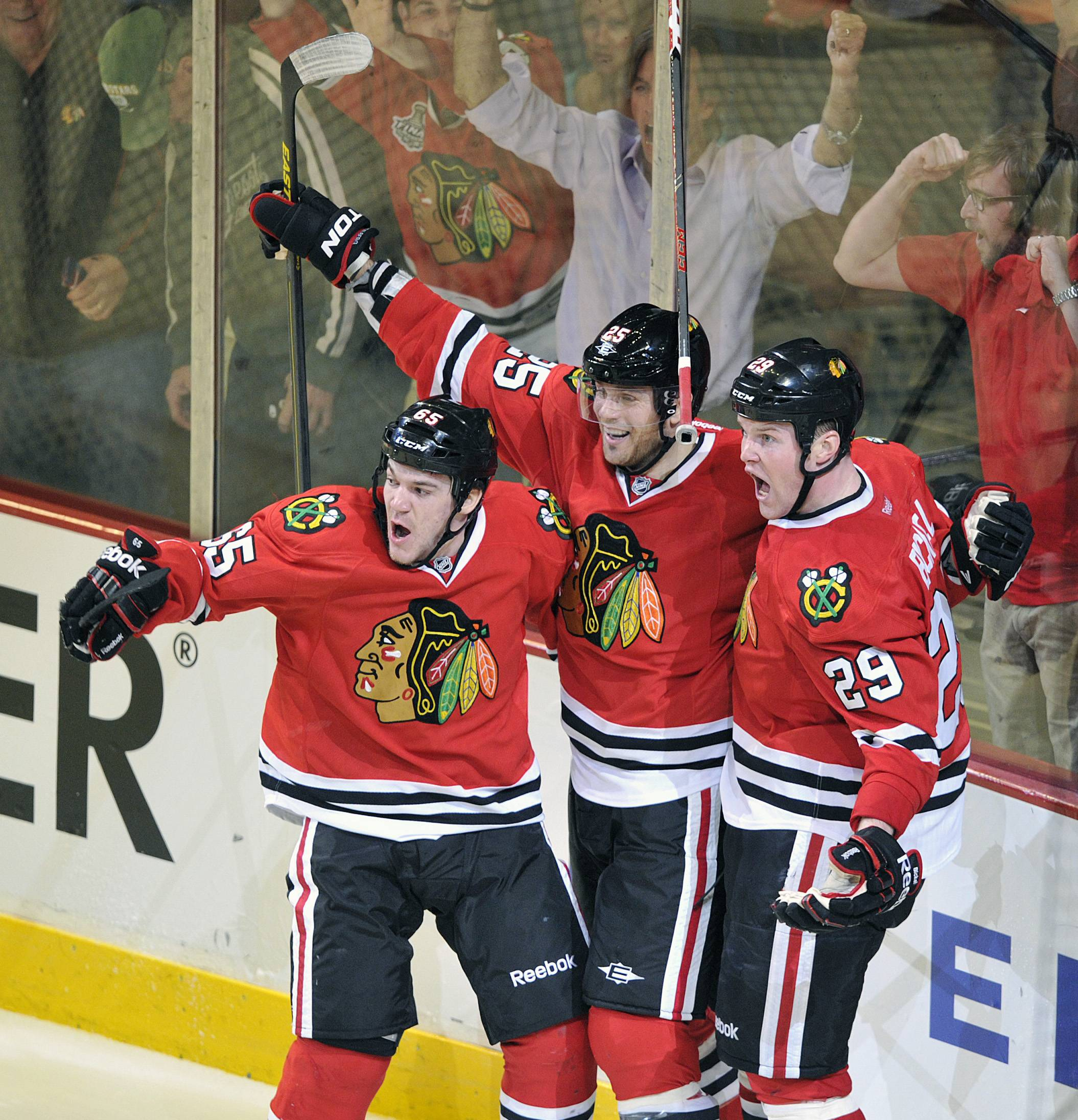 Chicago Blackhawks' Andrew Shaw left, Viktor Stalberg and Bryan Bickell (29) celebrate Bickell's game winning goal against the Minnesota Wild in overtime of Game 1 of an NHL hockey Stanley Cup playoff series Tuesday, April 30, 2013, in Chicago. The Blackhawks defeated the Wild 2-1.
