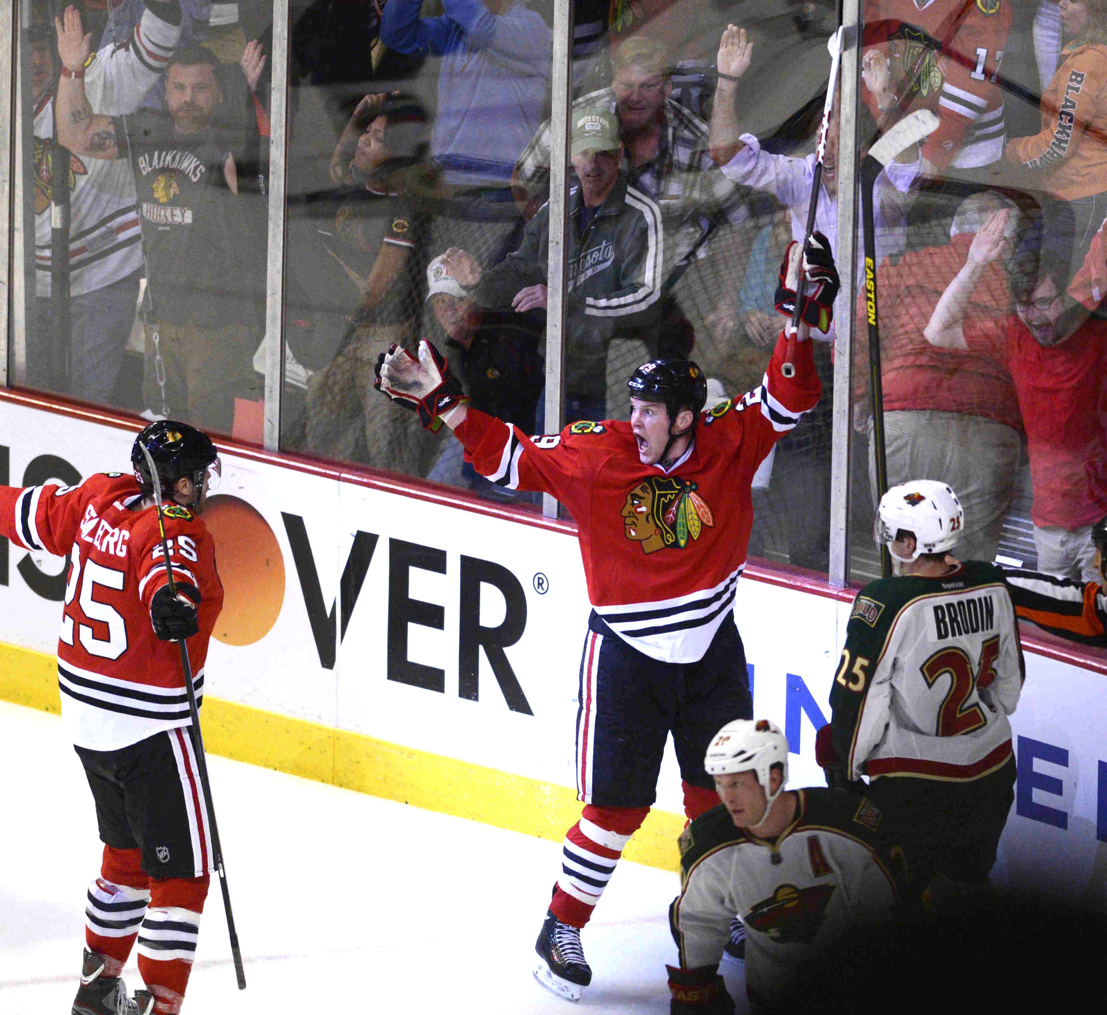 Chicago Blackhawks left wing Bryan Bickell turns to teammate Chicago Blackhawks left wing Viktor Stalberg after scoring the winning goal Tuesday in Game 1 of the Western Conference first-round playoff series at the United Center in Chicago.