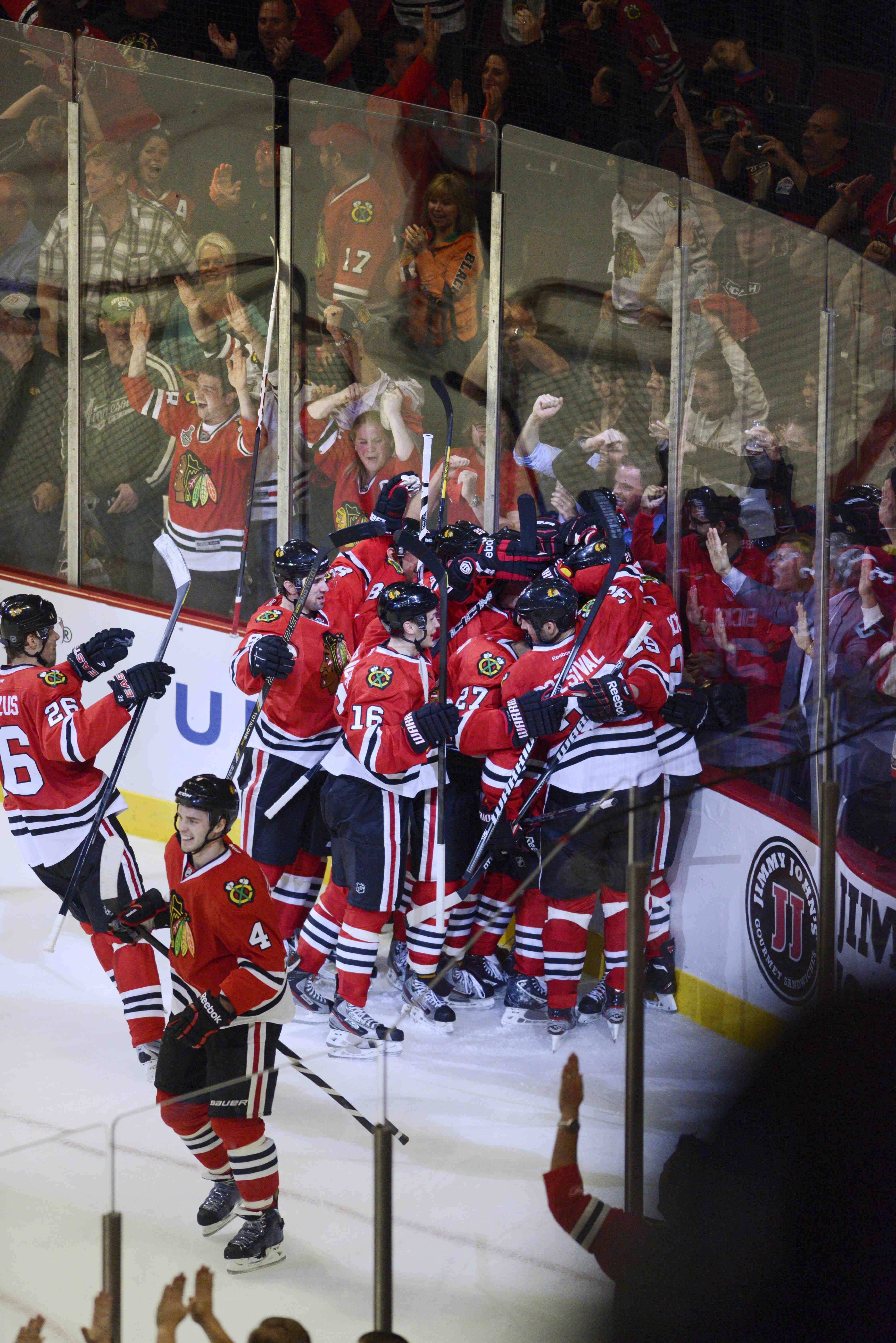 The Chicago Blackhawks celebrate the game winner by Bryan Bickell Tuesday in Game 1 of the Western Conference first-round playoff series at the United Center in Chicago.