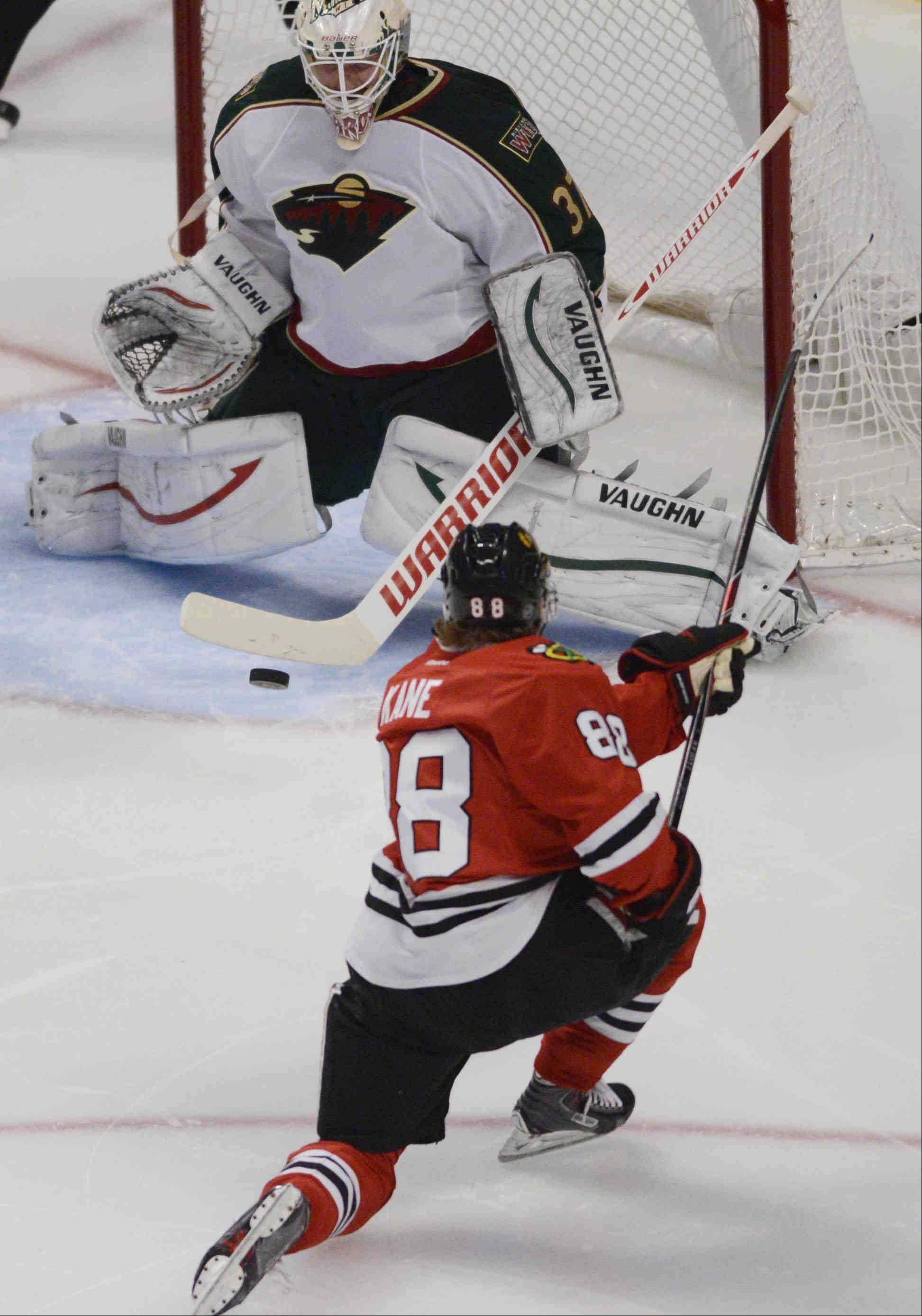 Chicago Blackhawks right wing Patrick Kane takes a shot on Minnesota Wild goalie Josh Harding . Harding stopped the shot in the second period.