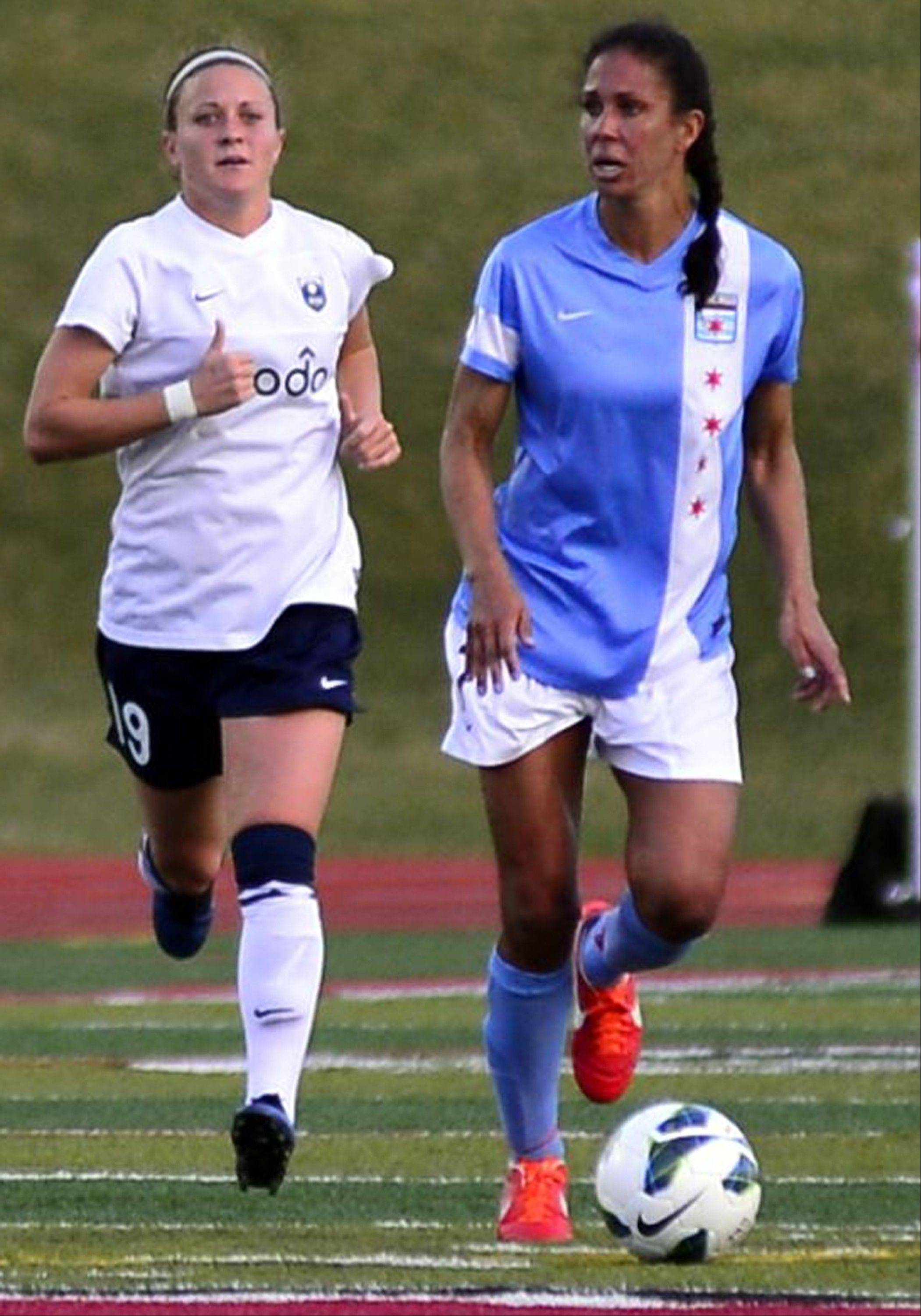 Chicago Red Stars midfielder Shannon Boxx, at right advancing the ball against Seattle, will undergo arthroscopic surgery on her right knee. She may miss the next 4-6 weeks of the NWSL season, as well as for Team USA.