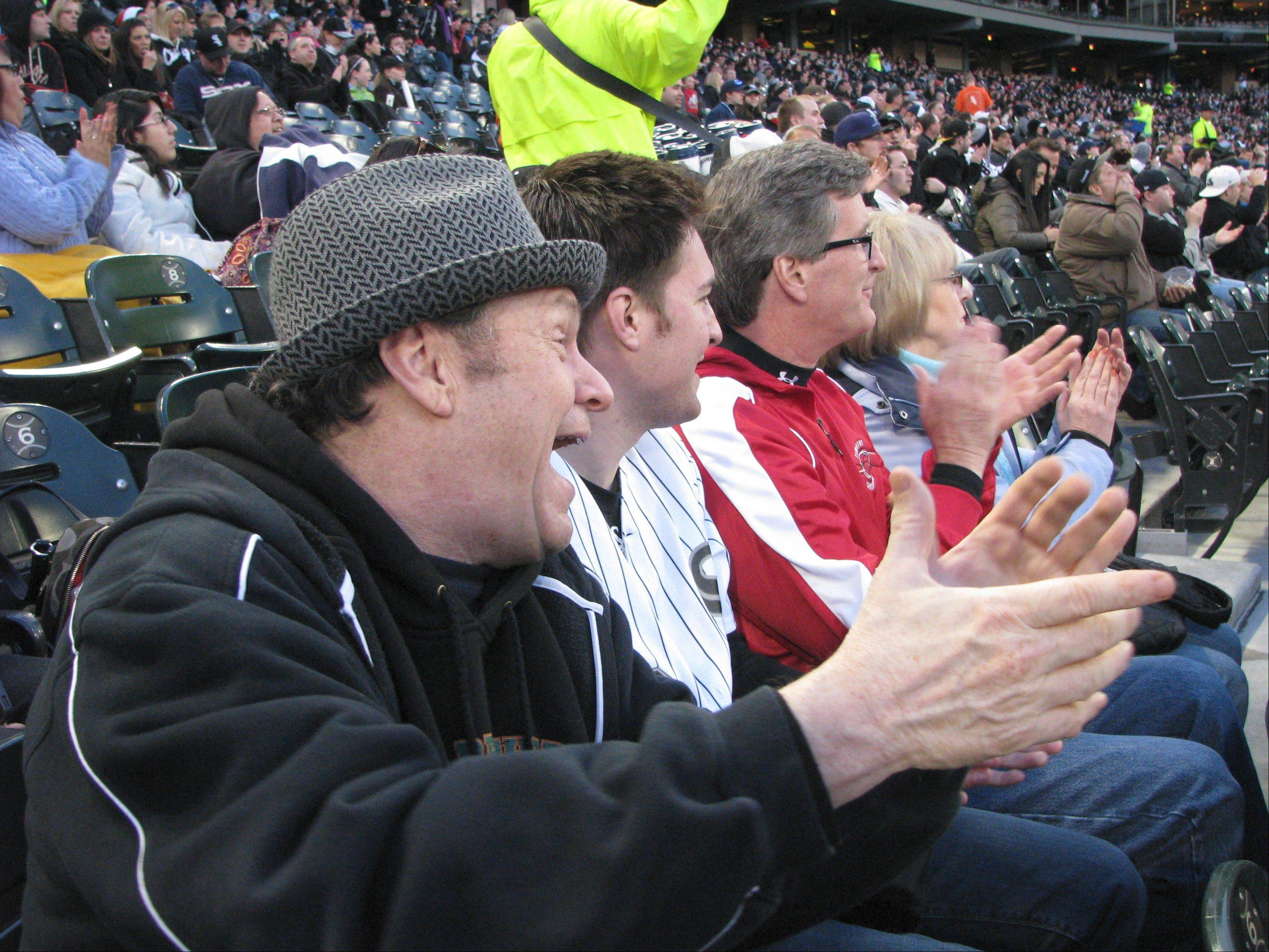 Mike North, left, enjoys a White Sox game last Thursday with three fans who joined him for the trip to U.S. Cellular Field: Jim Bowe, Mark Baumbach and Debbie Kaminski.