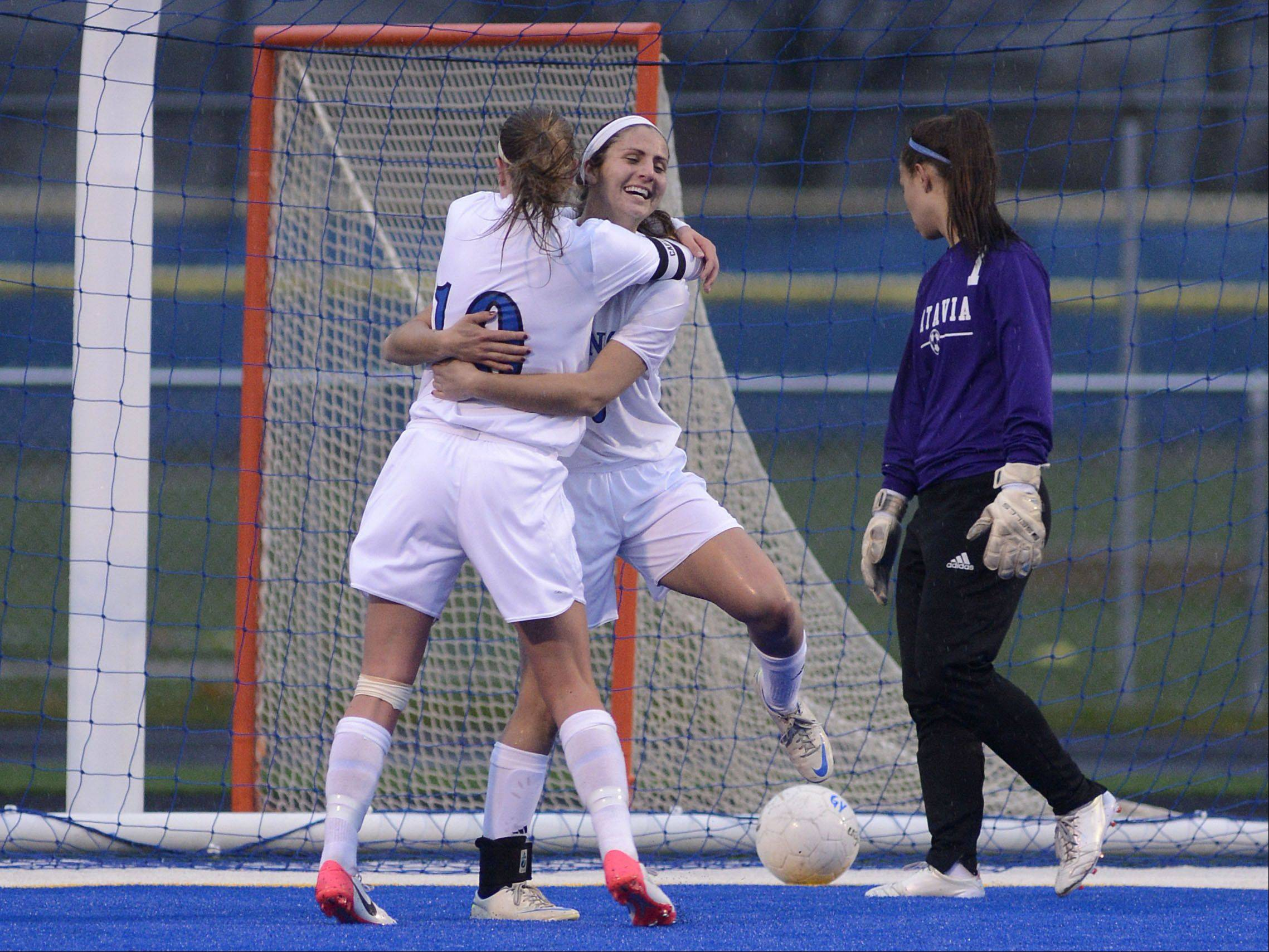 Geneva's Molly Axen, middle, celebrates her goal with teammate Amanda Lulek as Batavia goalie Nicki Seiton, right, looks back at the missed ball in Tuesday.