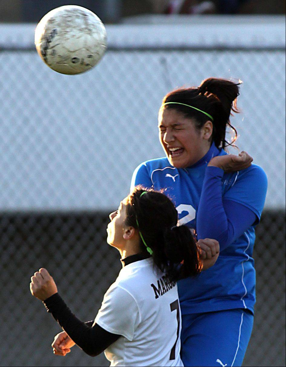 Larkin's Ana Leon, right, and Elgin's Maria Gomez battle for the ball during a varsity soccer game at Memorial Field in Elgin on Wednesday.