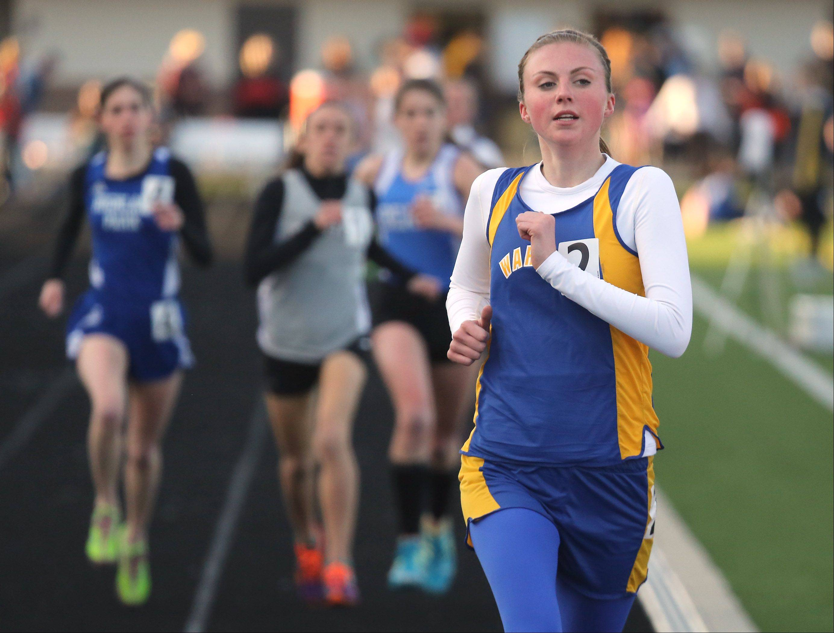 Warren's Meg Tully leads the 3200-meter run for much of the race before ending up second during the Lake County girls track meet Thursday at Grayslake North High School.