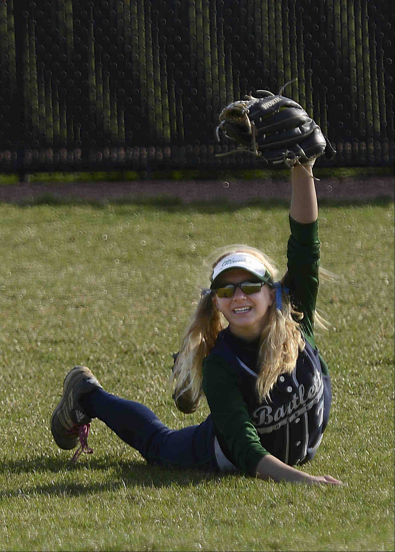 Bartlett's Rachel Odolski shows the umpire the ball after a diving catch Monday in St. Charles.