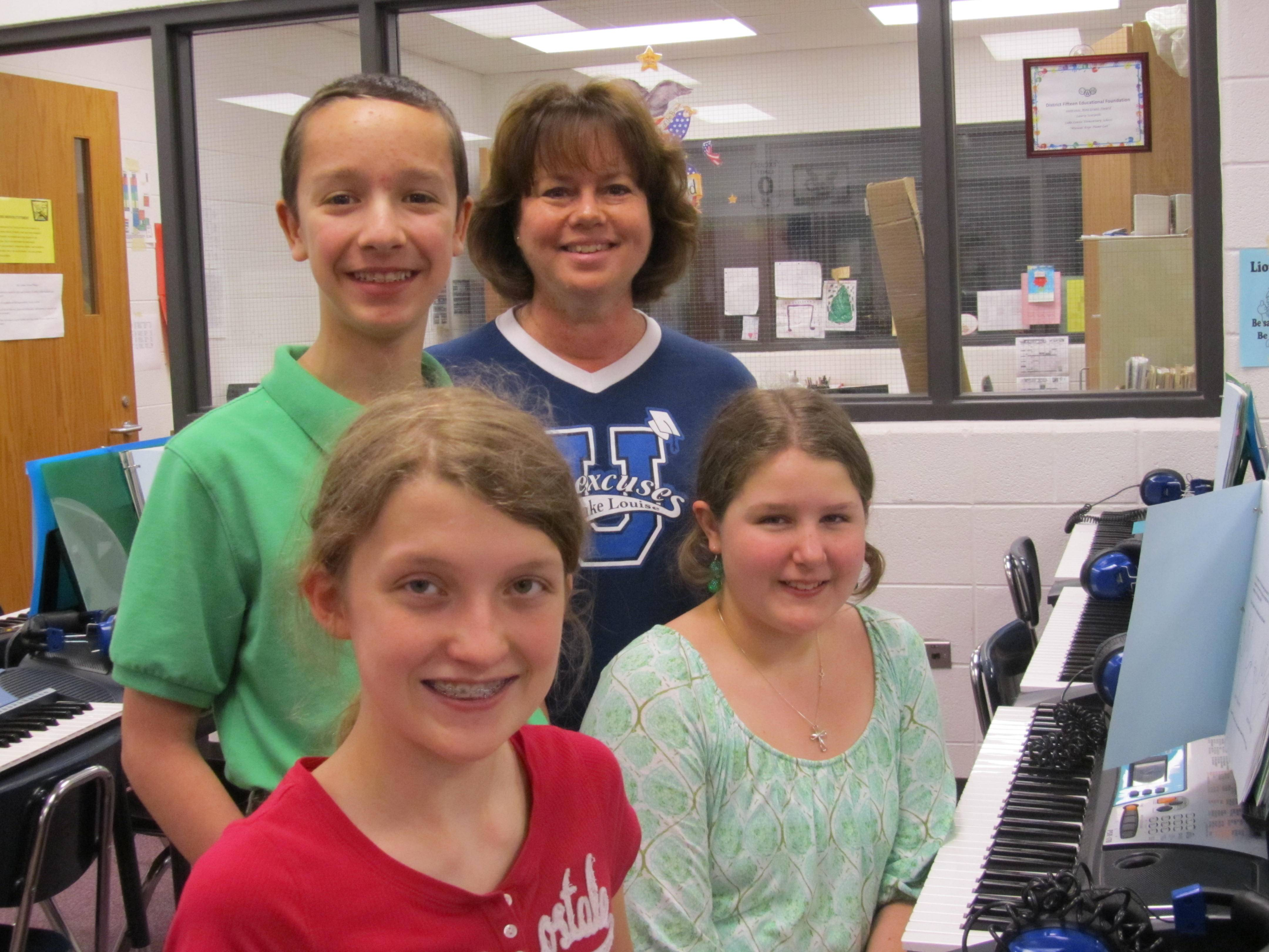 Back Row from Left: Kyle Cyr-Flessner, 6th Grade, Mrs. Laurie Scarpelli, Music Teacher. Front Row from Left: Haley Holz, 6th Grader, Katie Barclay, 6th Grader.  Photo taken in Lake Louise Music Room, 4/29/13