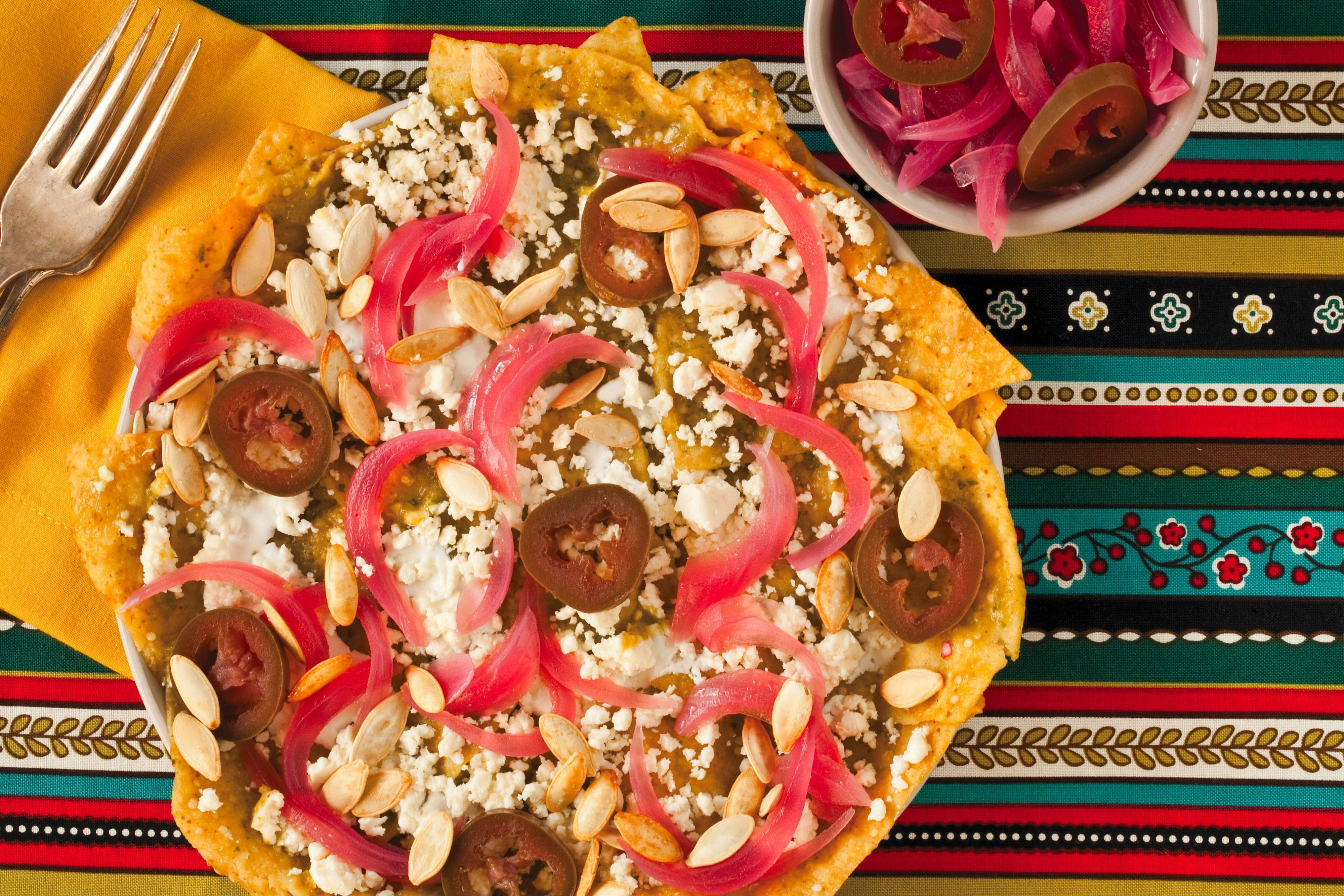 Pickled red onion and jalpeno add piquant flavors to chilaquilas.