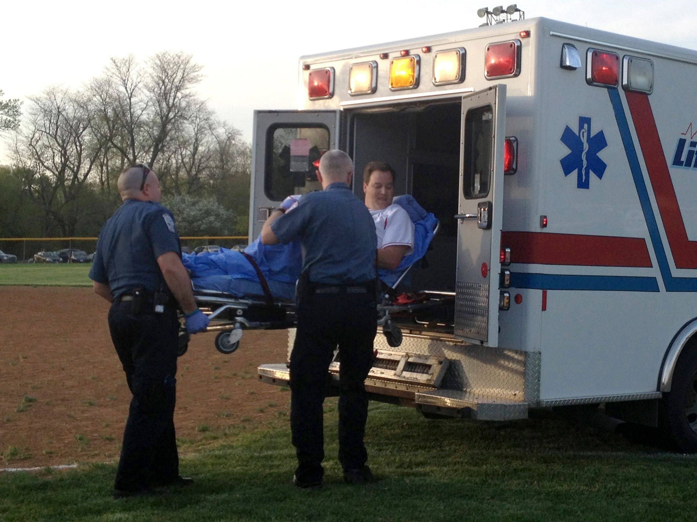 State Sen. Matt Murphy, a Palatine Republican, was loaded into an ambulance Wednesday after being injured in the annual softball game between the Illinois House and Senate in Springfield. .