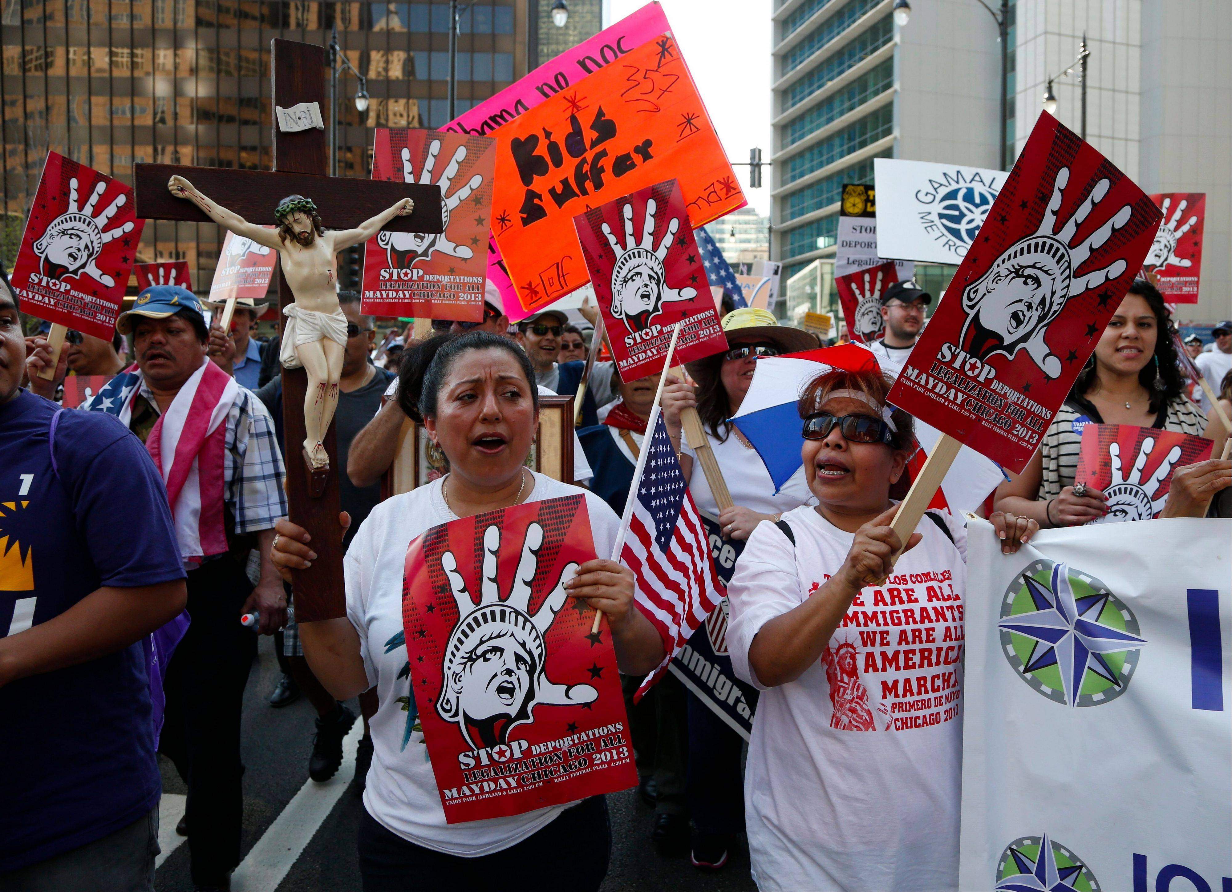 Immigrants and activists march Wednesday in Chicago to urge comprehensive immigration reform.