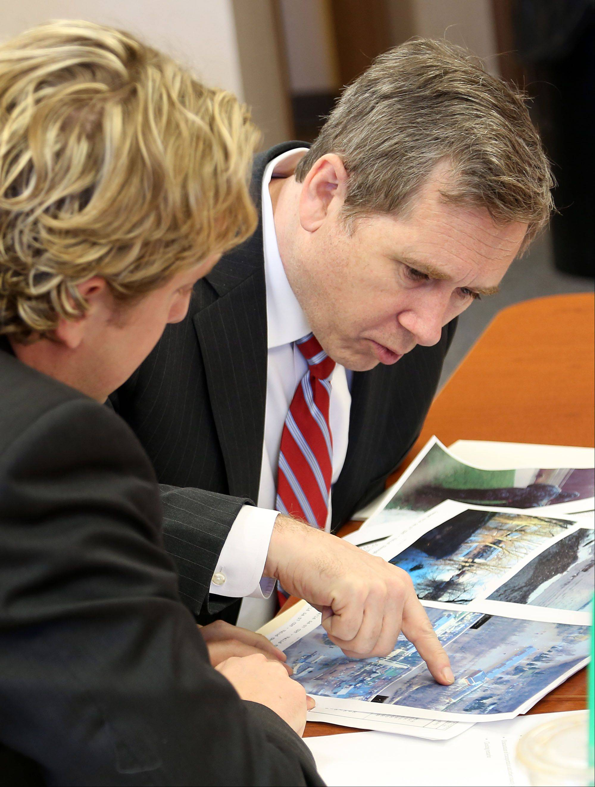 U.S. Sen. Mark Kirk, right, and Lake County Chairman Board Aaron Lawlor look over maps of flooded areas during a meeting at the Lake County Division of Transportation in Libertyville Wednesday. Kirk said he was impressed with the county's efforts tracking the flood.
