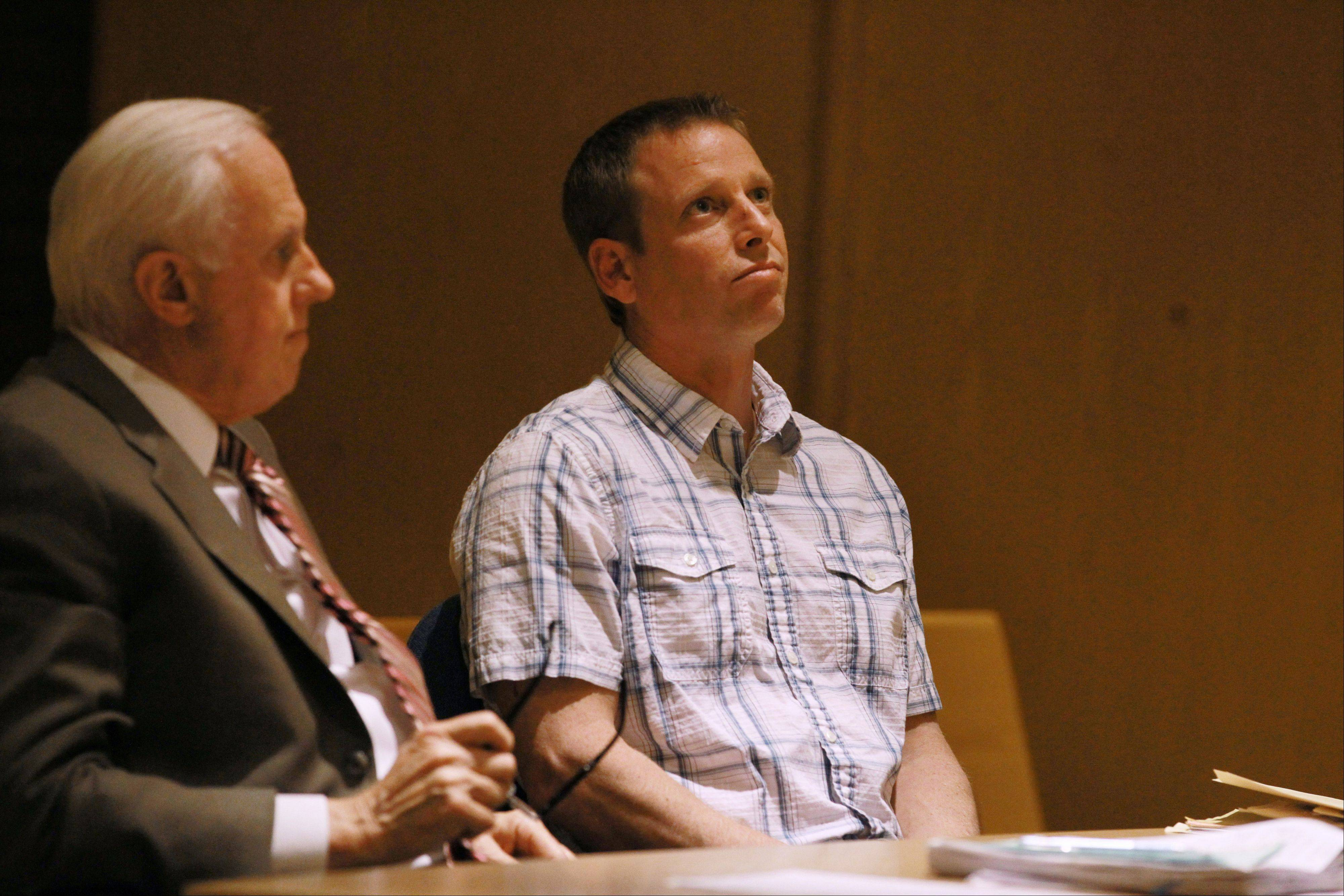 Timothy Morrow, 43, of Round Lake Beach, right, and his defense attorney Mike Norris listen to Lake County Judge Brian P. Hughes issue his sentence Wednesday at the Lake County courthouse in Waukegan. Hughes sentenced Morrow to 13 years in prison for his eighth DUI conviction.