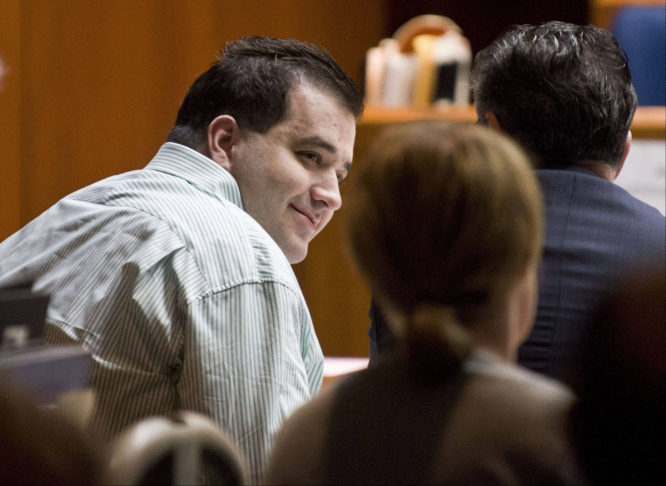 Defendant Johnny Borizov talks with his lawyers Tuesday at his murder trial in Wheaton.
