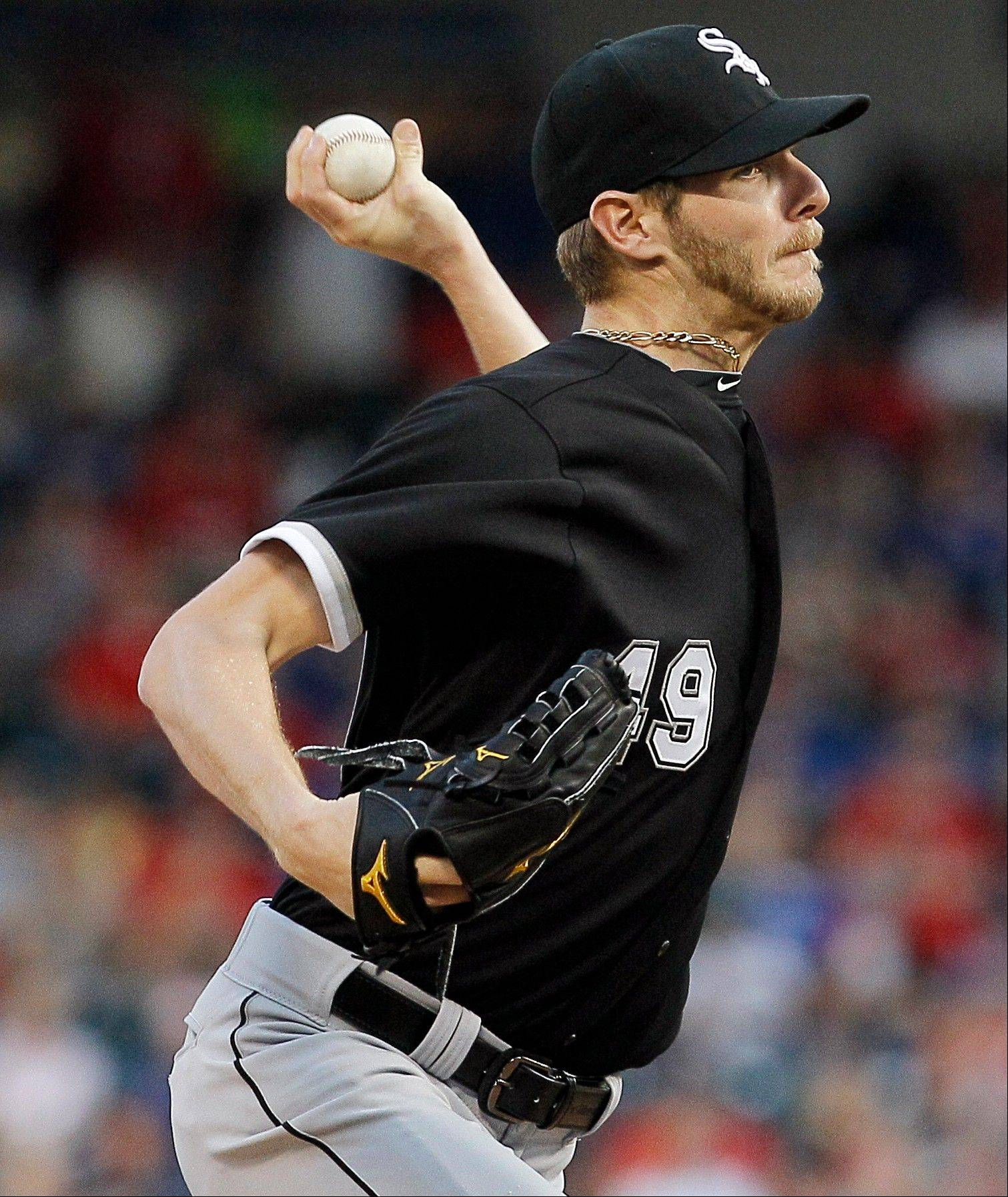 Chicago White Sox starting pitcher Chris Sale (49) throws in the first inning of a baseball game against the Texas Rangers in Arlington, Texas, Wednesday, May 1, 2013. (AP Photo/Brandon Wade)