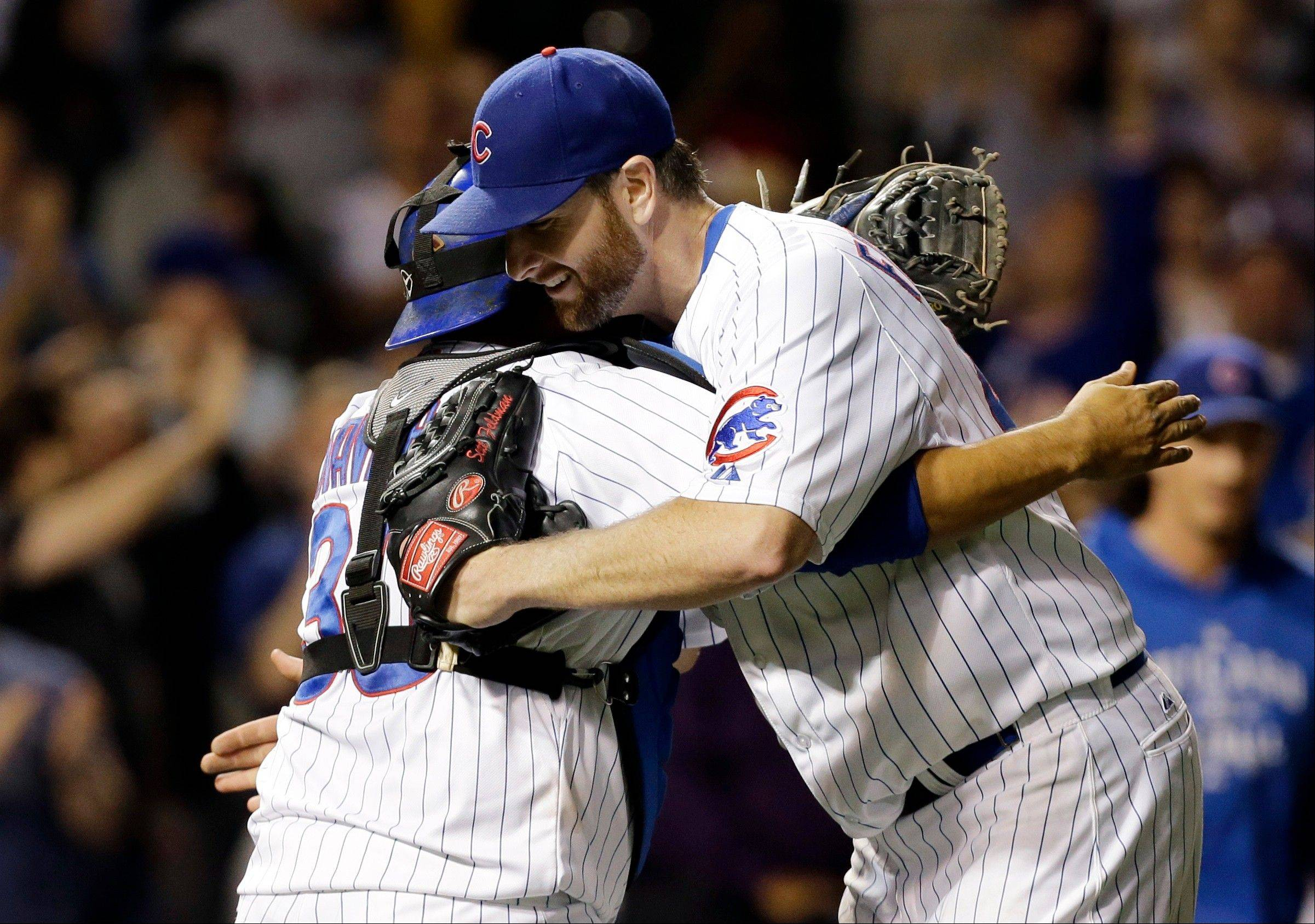 Chicago Cubs starter Scott Feldman, right, celebrates with catcher Dioner Navarro after the Cubs defeated the San Diego Padres 6-2 in a baseball game in Chicago, Wednesday, May 1, 2013. (AP Photo/Nam Y. Huh)