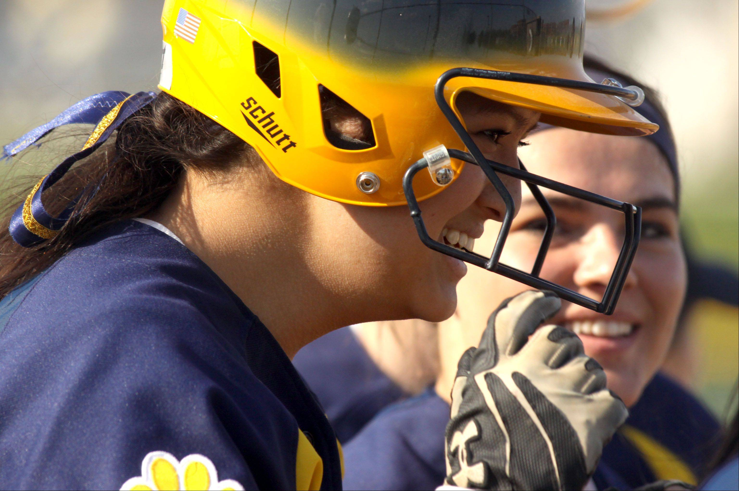 Neuqua Valley�s Alyssa Domico is all smiles after slugging a home run at South Elgin Wednesday.