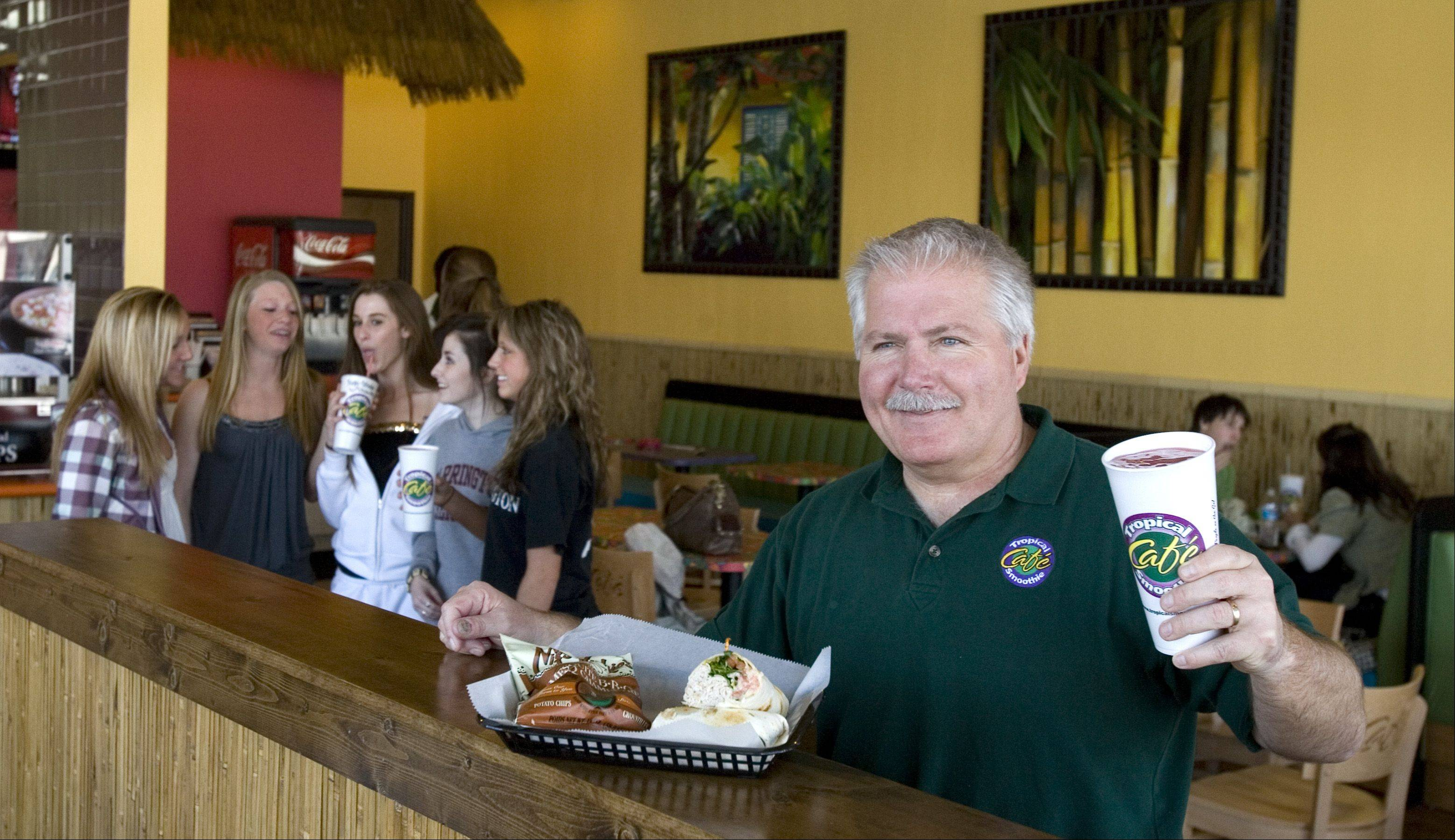 In this 2008 file photo, Brian Guinter serves sandwiches and smoothies at his Tropical Smoothie Cafe in Barrington. It closed last week and Meatheads will replace it.
