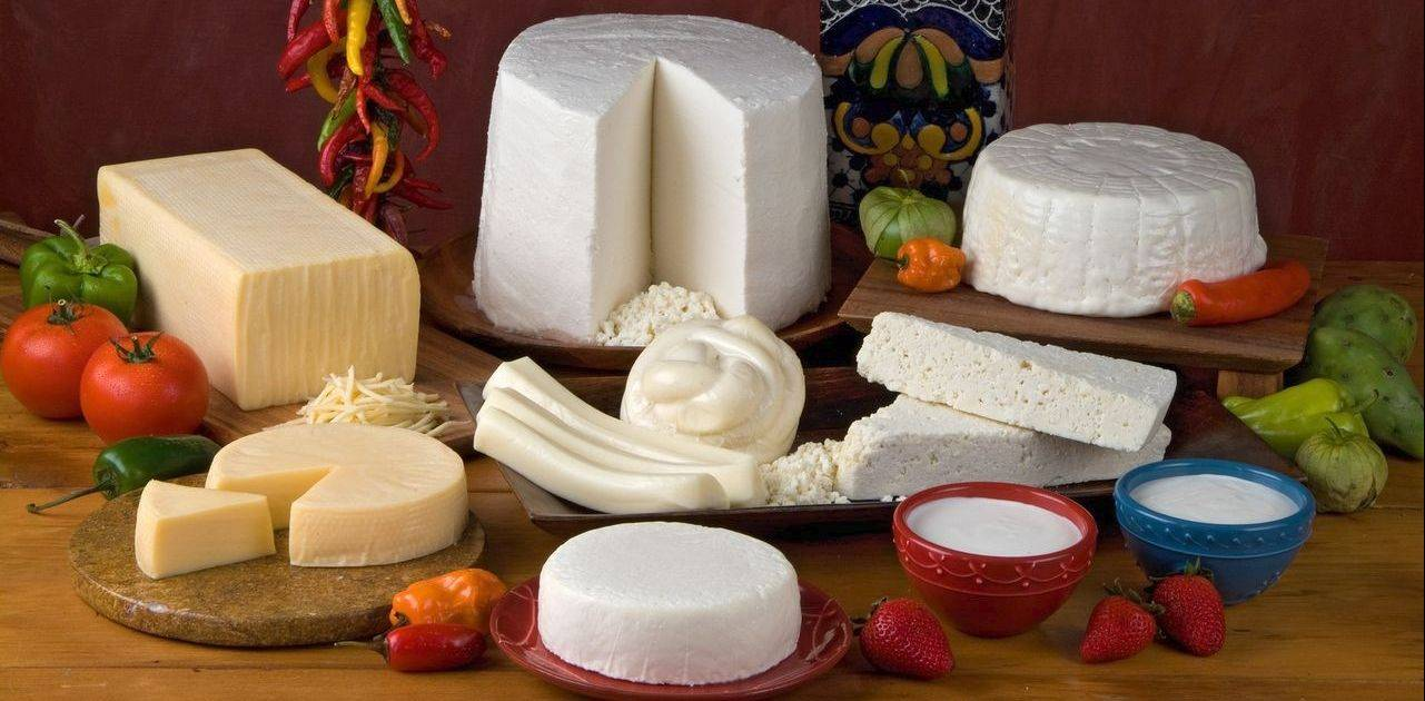 A variety of Mexican-style cheeses are now widely available. Duranguense, fresco and panela are in the back row. In the middle are round Duranguense, Oaxaca ball and strips and cotija wedges. And up front are fresco and crema real (sour cream).