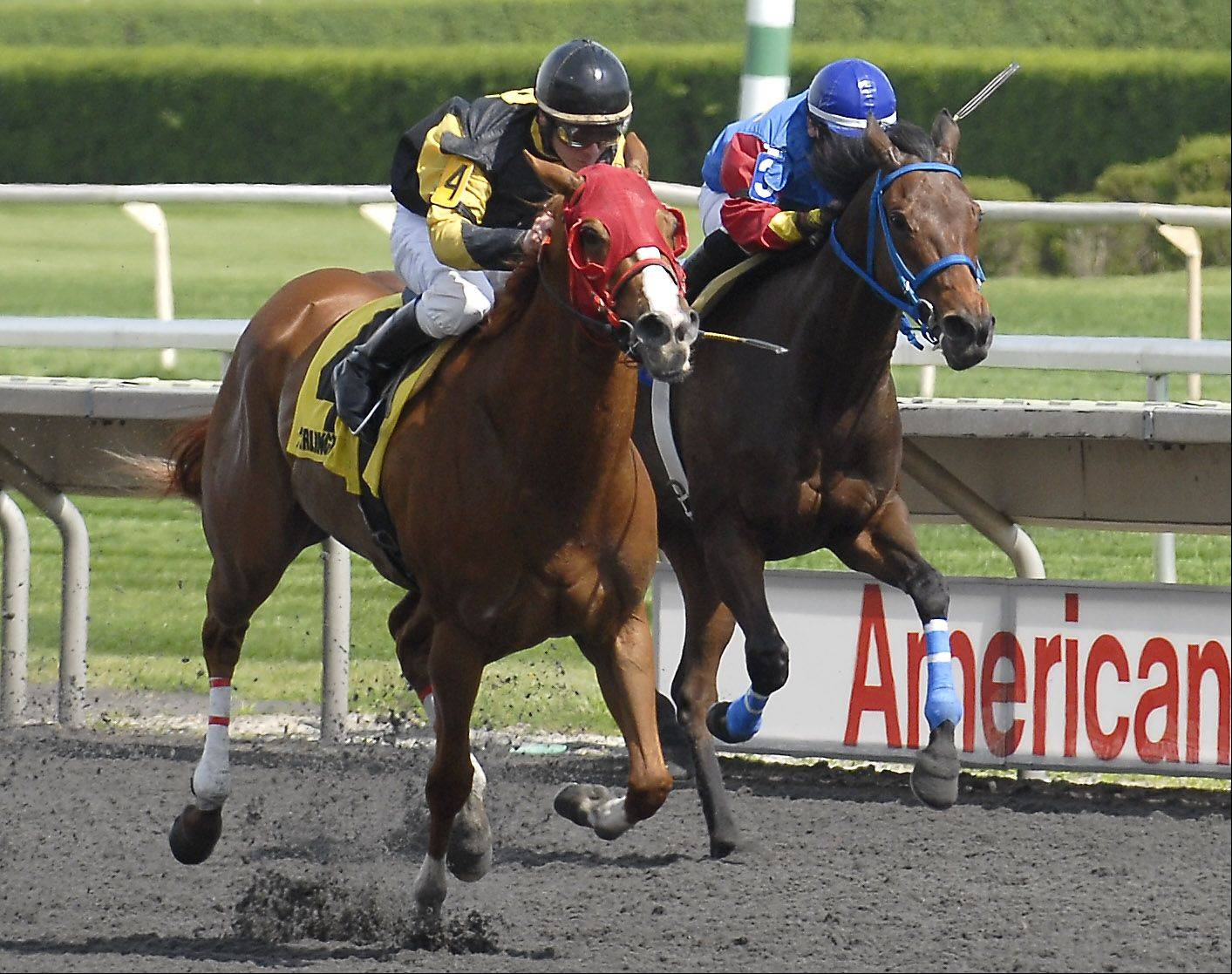 Cyberphobe, left, and Kentucky Gal duked it out in the first race on opening day last year at Arlington International Racecourse in Arlington Heights. Opening day is Friday, May 3.