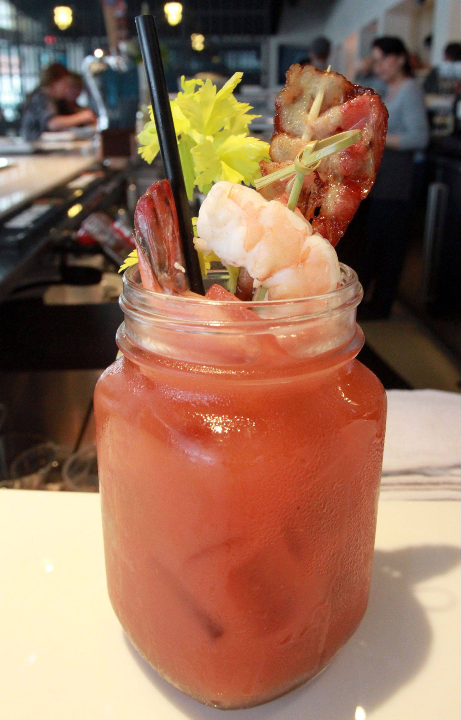 No longer a drink just to cure hangovers, a Bloody Mary, like this one at e+o Food and Drink in Mount Prospect, has become a Sunday morning icon.