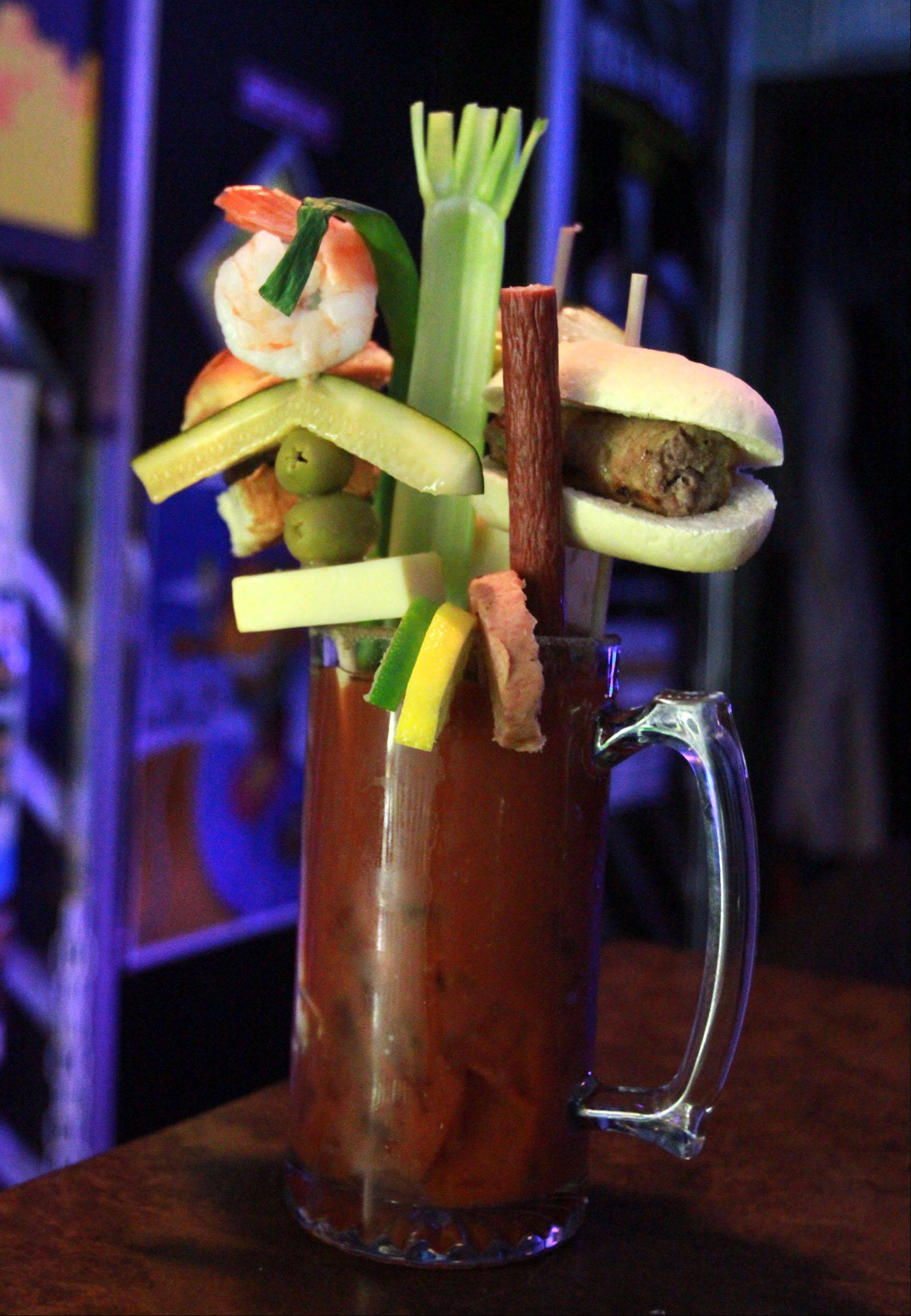 "The Mega Mary at Route 12 Bar and Grill in Fox Lake is ""garnished"" with a mini steak burger and a brat, among other items."