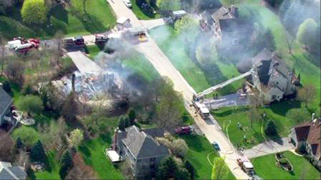 At least four houses caught fire Wednesday in a subdivision along the 3200 block of Carrington Drive in Crystal Lake.
