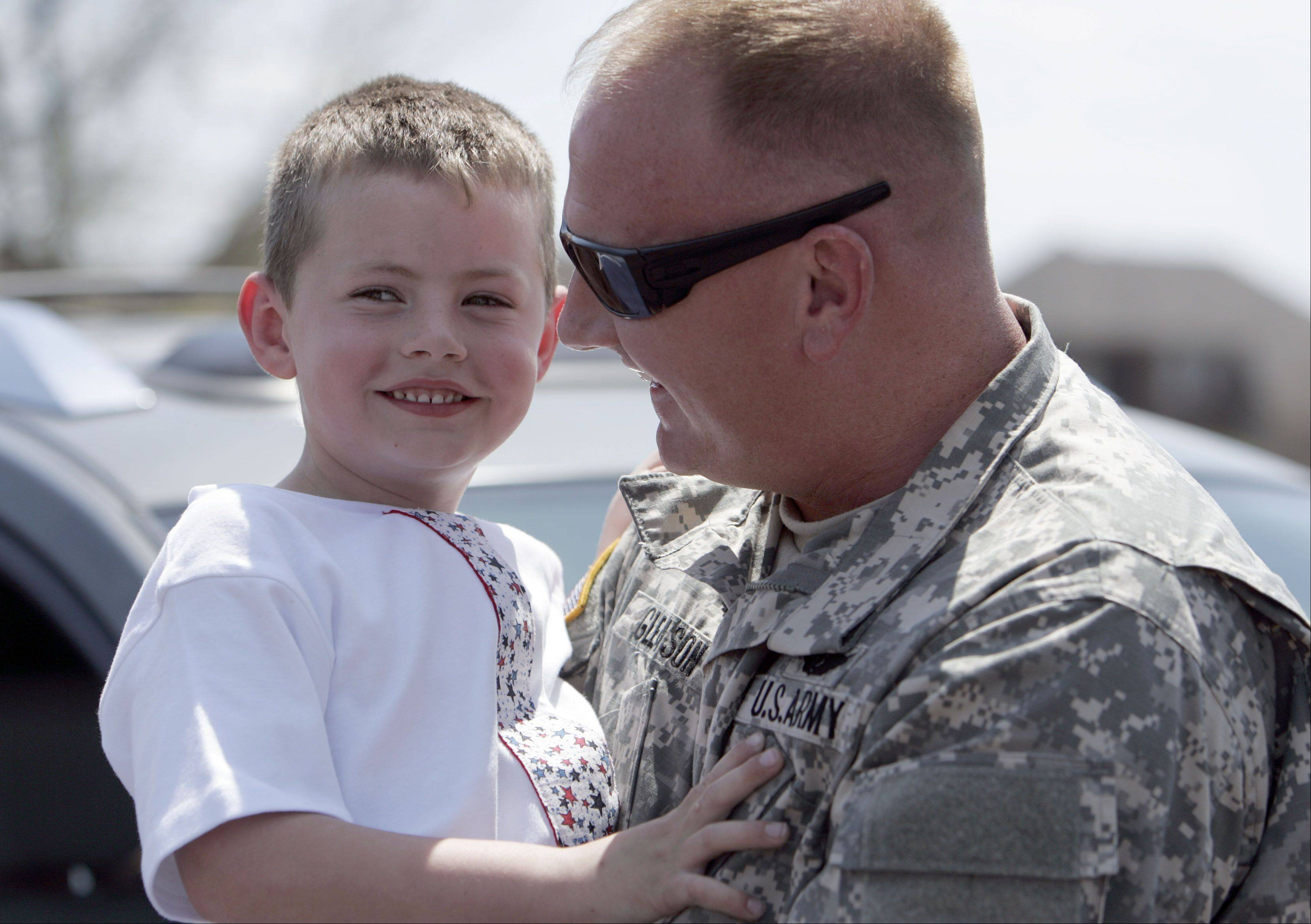 T.J. Gleason, 5, enjoys a moment with his dad, Sgt. 1st Class Tim Gleason, Wednesday at Corron Elementary School in South Elgin. Gleason returned home Wednesday from his second deployment to Kuwait.