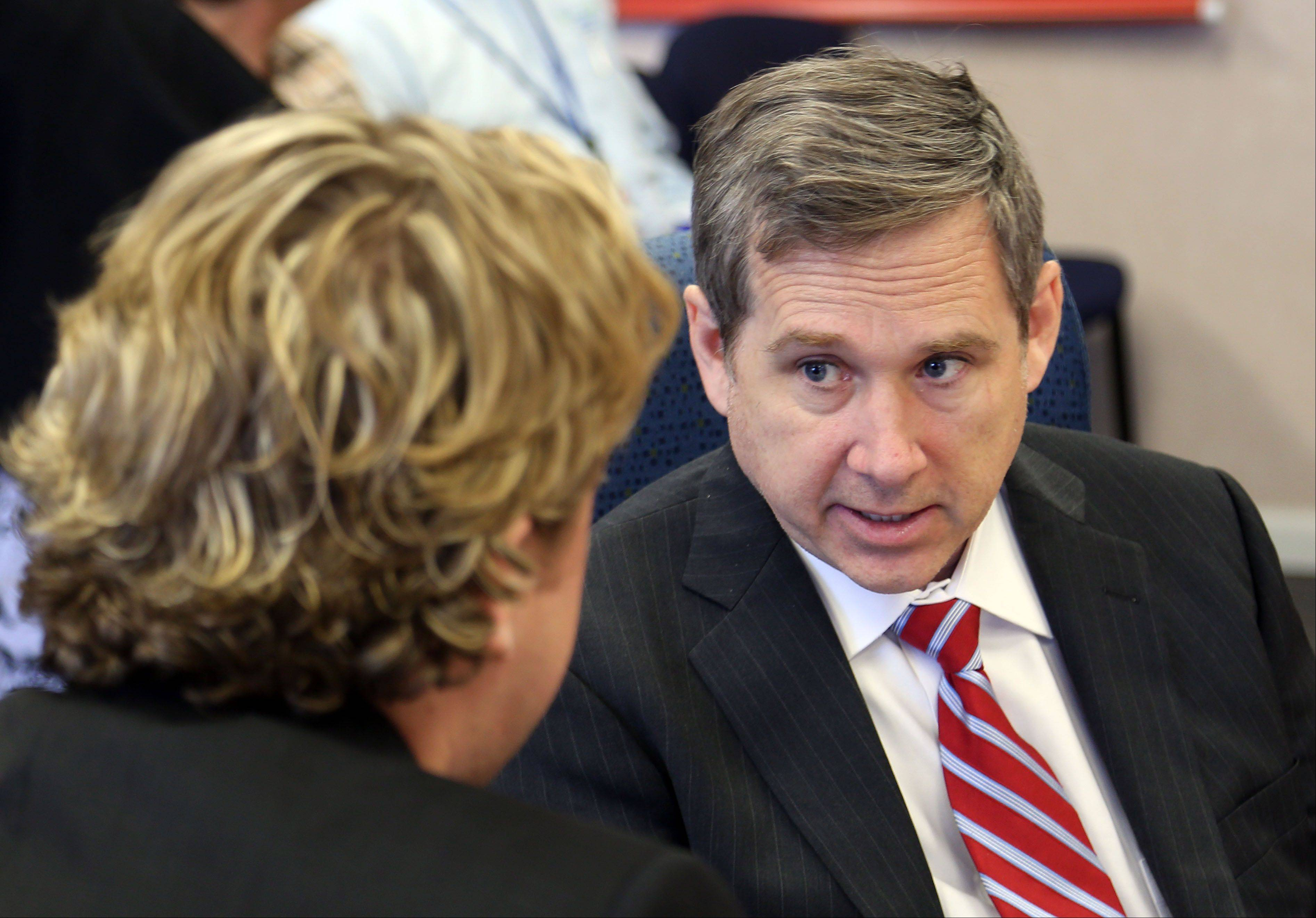 U.S. Sen. Mark Kirk talks with Lake County Chairman Board Aaron Lawlor during a meeting Wednesday at the Lake County Division of Transportation in Libertyville. Kirk met with local leaders to discuss recent flooding and transportation issues.