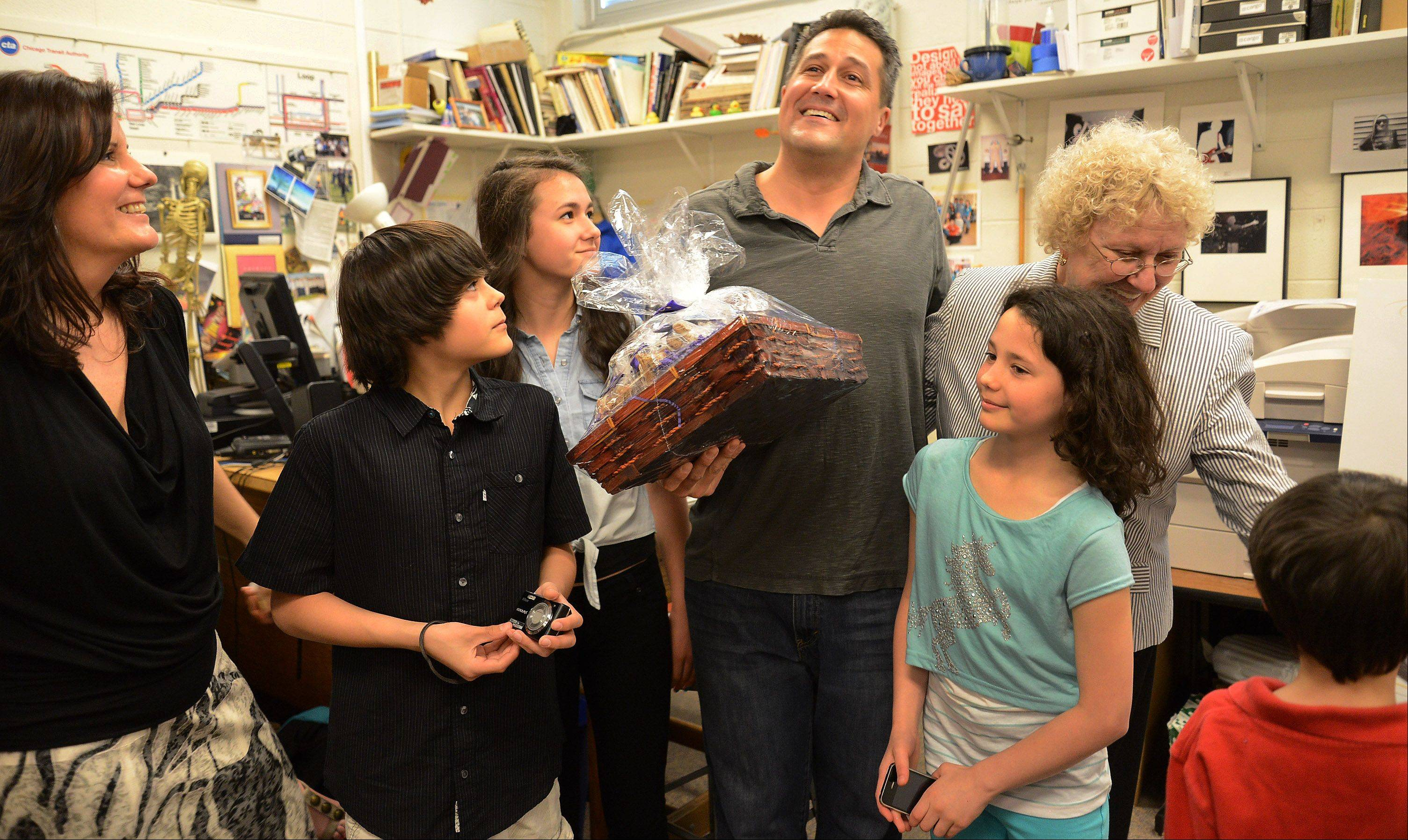 Golden Apple recipient Gregory Regalado, who teaches art, photography and advanced digital imaging at Maine West High School in Des Plaines, is surrounded by his family. From left, wife Sue, son Jax, daughter Isabel, daughter Kayci, mother Beverly and son Luke.