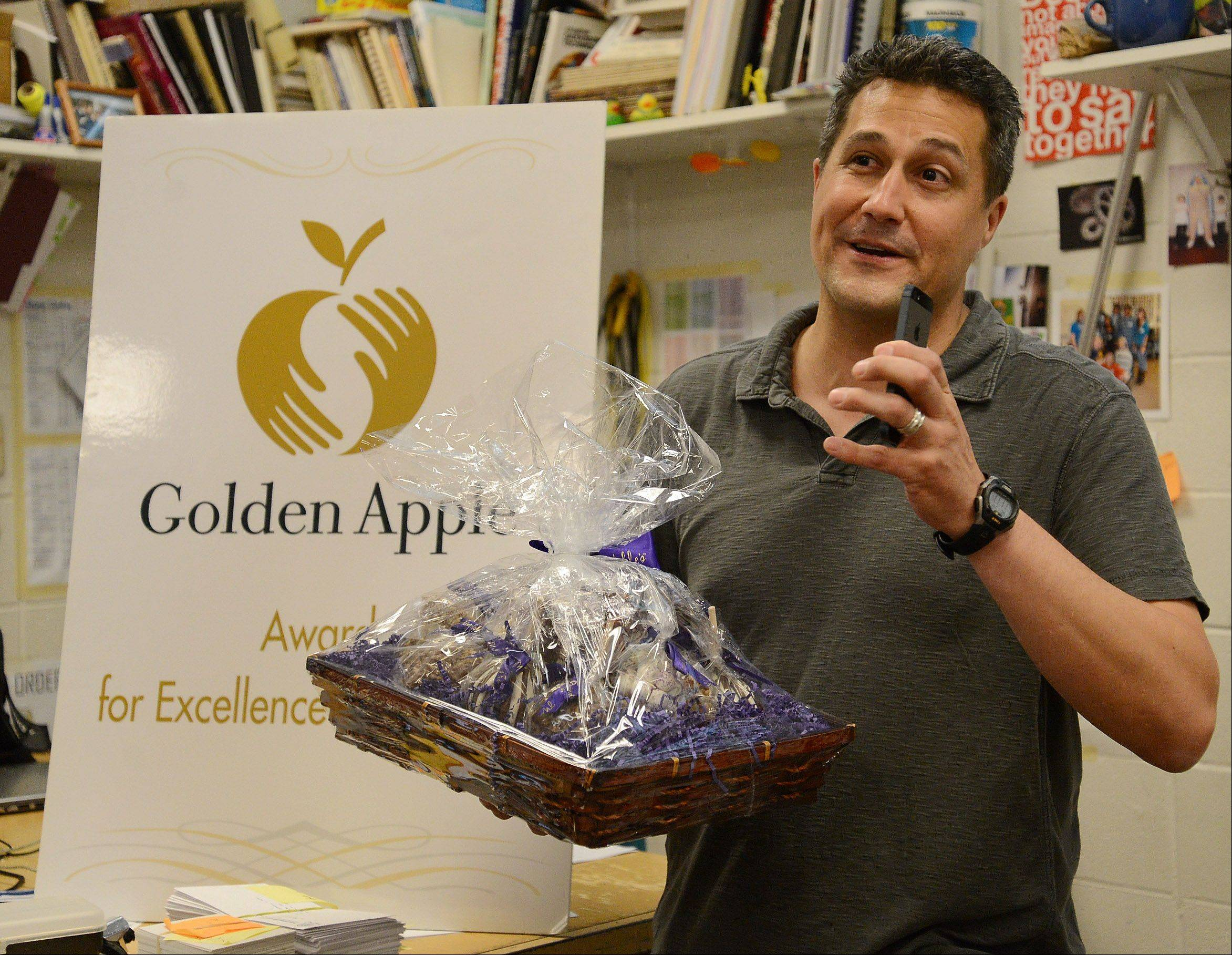 Gregory Regalado, who teaches art, photography and advanced digital imaging at Maine West High School in Des Plaines, was surprised with the news Wednesday that he's been chosen for the coveted Golden Apple Award for Excellence in Teaching. Regalado recorded the moment with his phone.