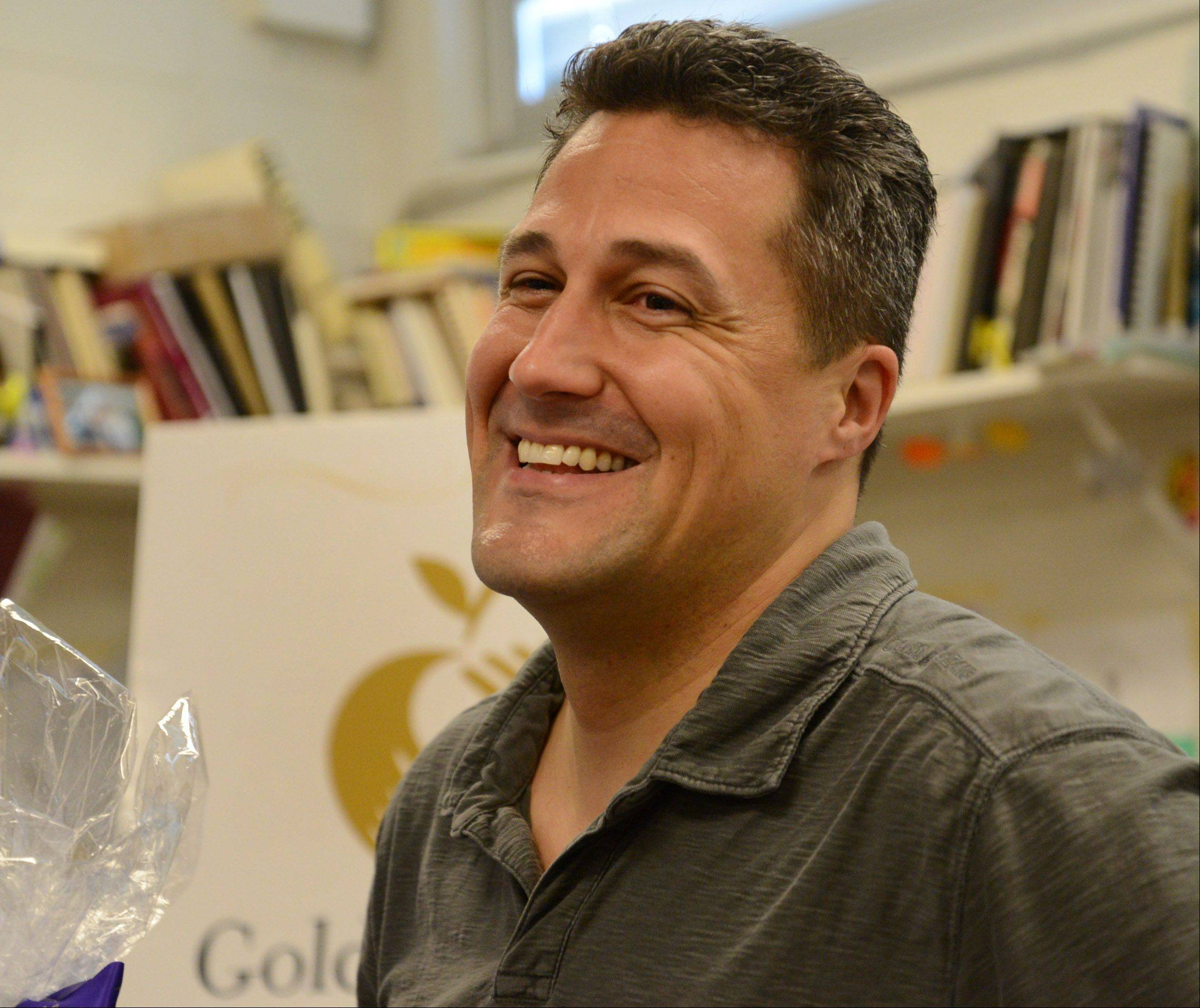 Gregory Regalado, who teaches art, photography and advanced digital imaging at Maine West High School in Des Plaines, was surprised with the news Wednesday that's he's been chosen for the coveted Golden Apple Award for Excellence in Teaching. Only 10 teachers statewide receive the honor each year.