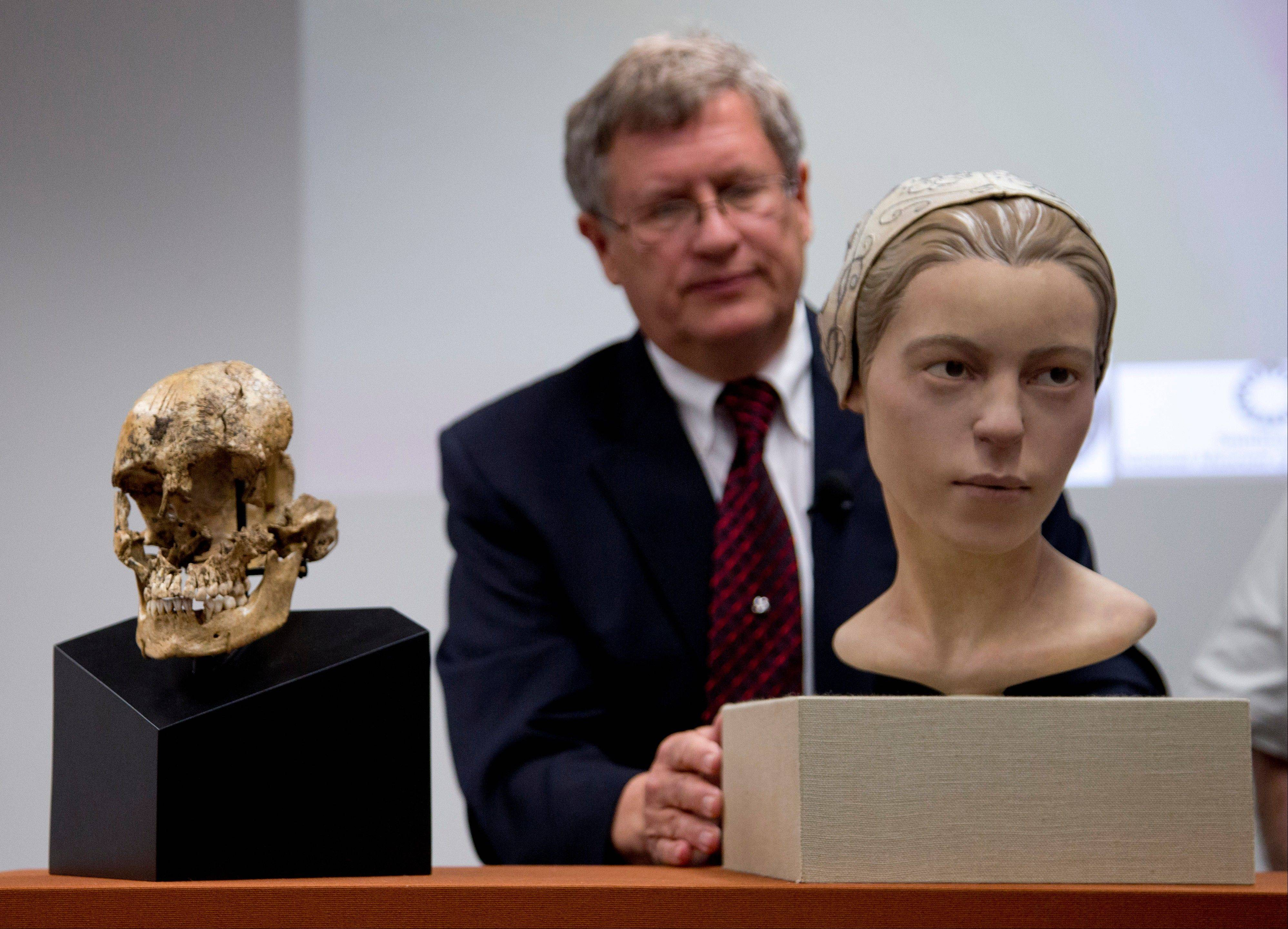 "Doug Owsley, division head for Physical Anthropology at the Smithsonian's National Museum of Natural History, displays the skull and facial reconstruction of ""Jane of Jamestown"" during a news conference at the museum in Washington, Wednesday, May 1, 2013. Scientists announced during the news conference that they have found the first solid archaeological evidence that some of the earliest American colonists at Jamestown, Va., survived harsh conditions by turning to cannibalism presenting the discovery of the bones of a 14-year-old girl, ""Jane"" that show clear signs that she was cannibalized."