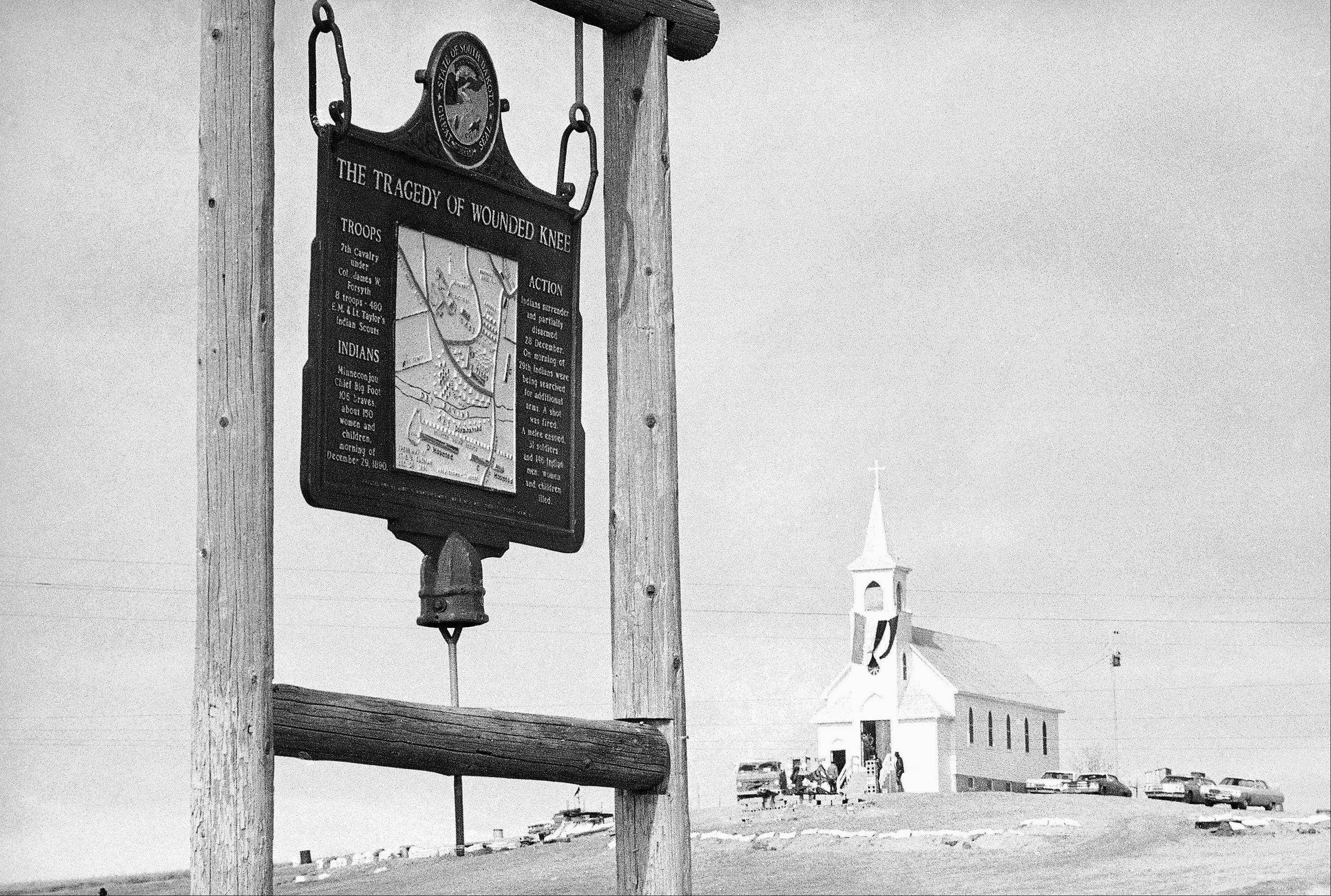 The historical marker commemorating the Wounded Knee Massacre of 1890 on the road near the Sacred Heart Catholic Church in Wounded Knee, S.D. Wednesday is the final day a landowner has given the Oglala Sioux Tribe to make an offer to buy a portion of the Wounded Knee National Historic Landmark.