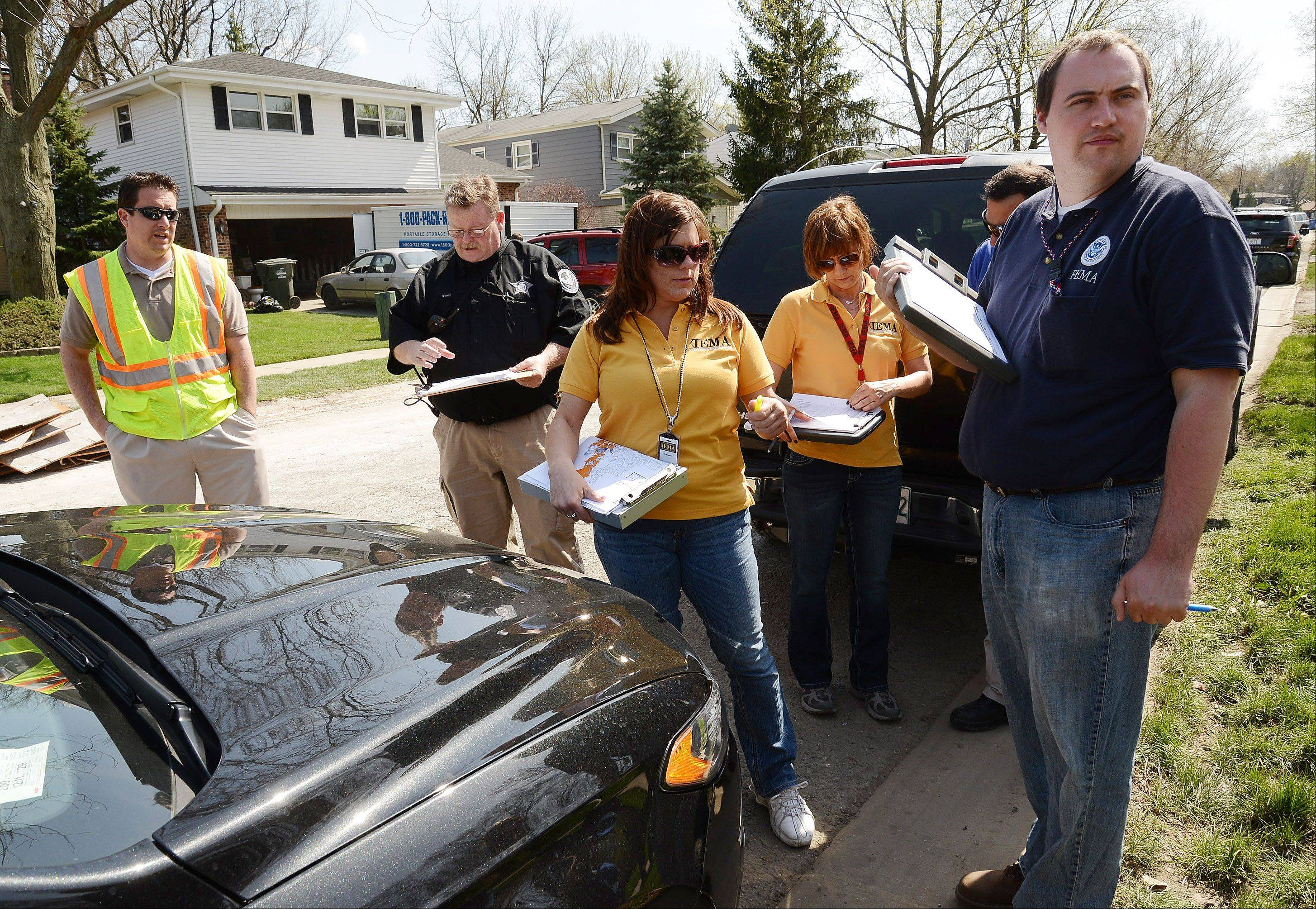 FEMA workers toured Big Bend Drive and other areas of Des Plaines on Tuesday to assess the damage from recent flooding. Their findings will help determine whether the city is declared a disaster area, making residents eligible for federal assistance.