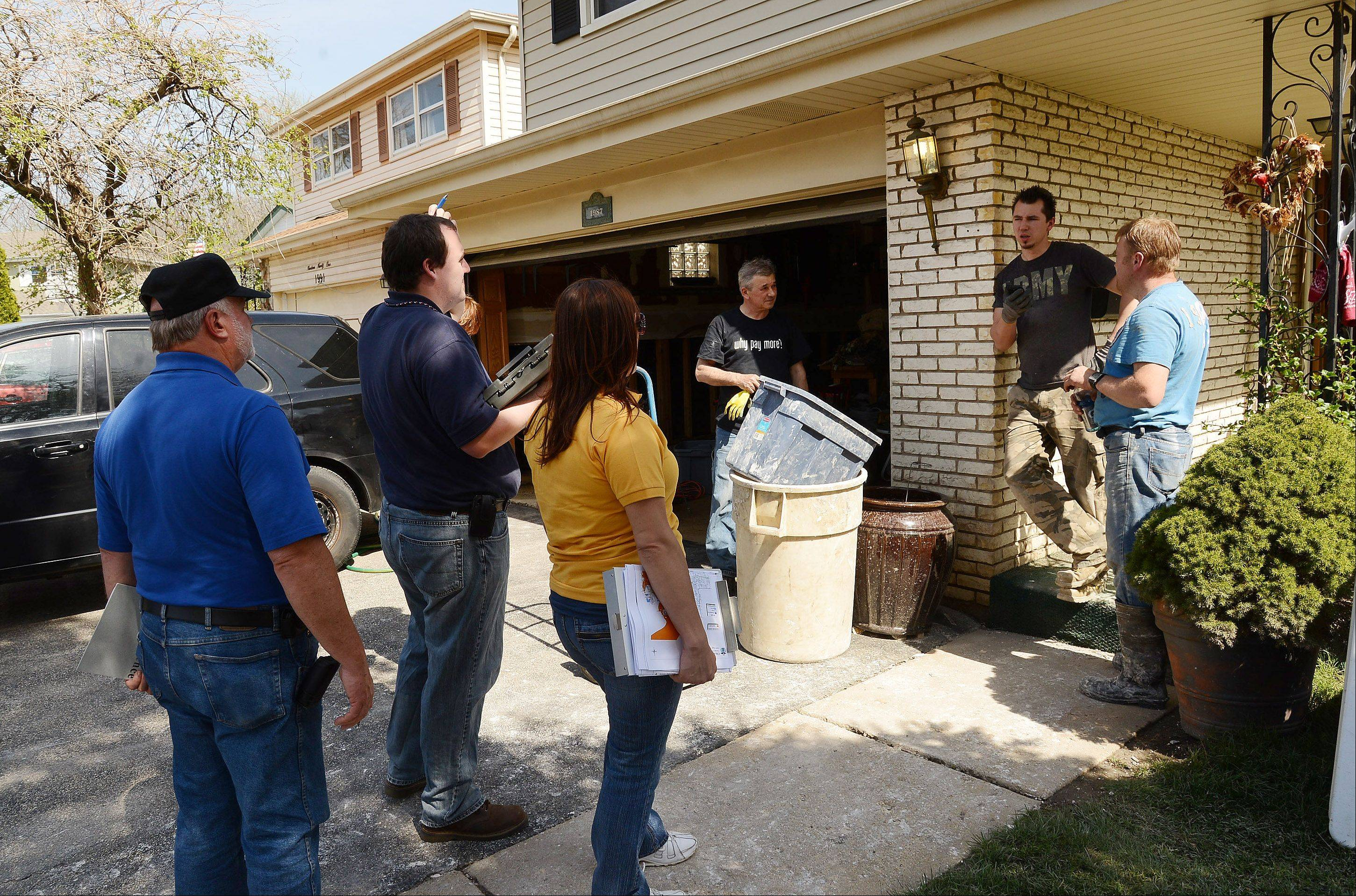 FEMA workers spoke with property owners along Big Bend Drive in Des Plaines on Tuesday to assess the damage from recent flooding. Their findings will help determine whether the city is declared a disaster area, making residents eligible for federal assistance.