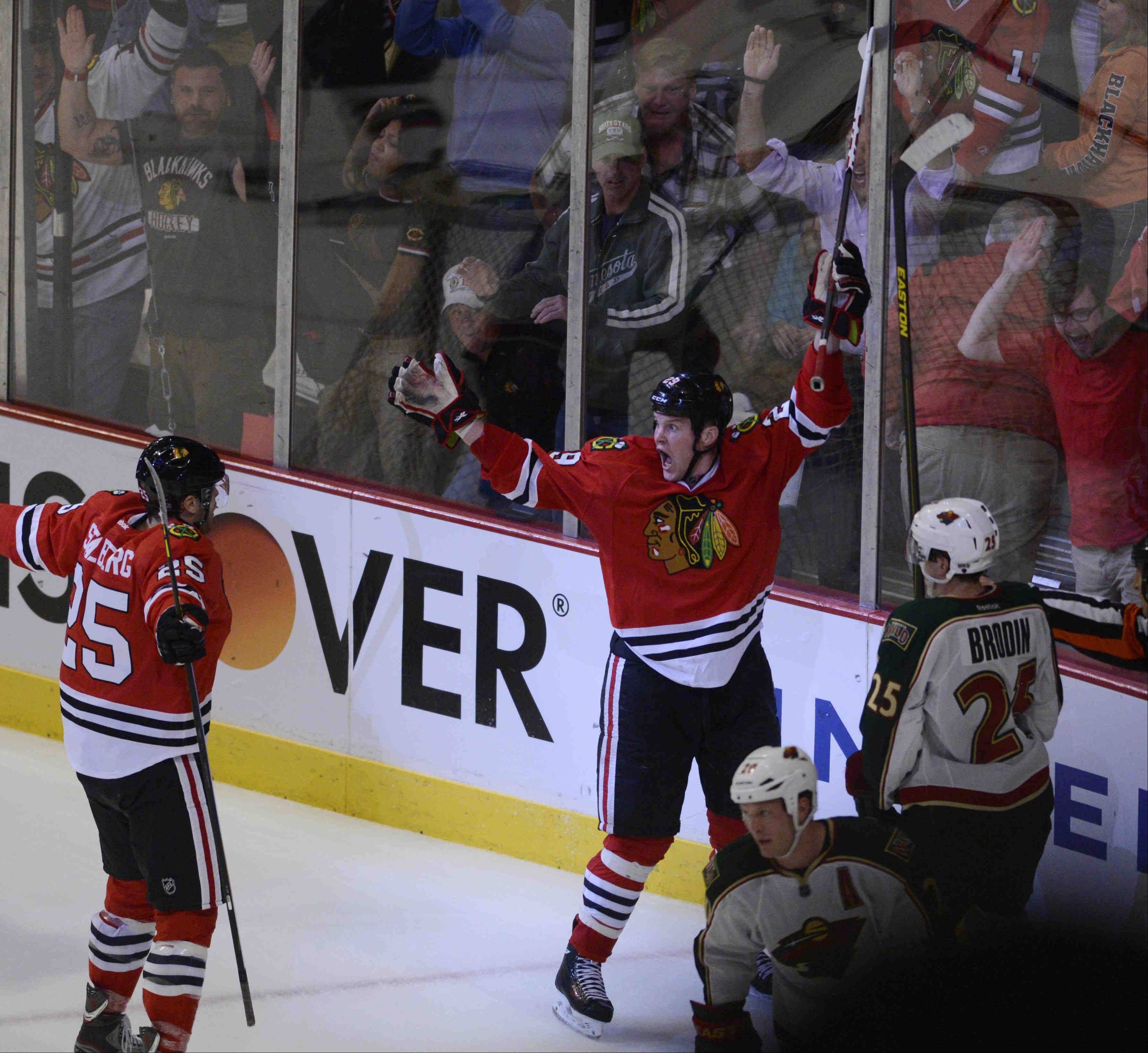 Blackhawks left wing Bryan Bickell celebrates his winning goal in overtime last night.
