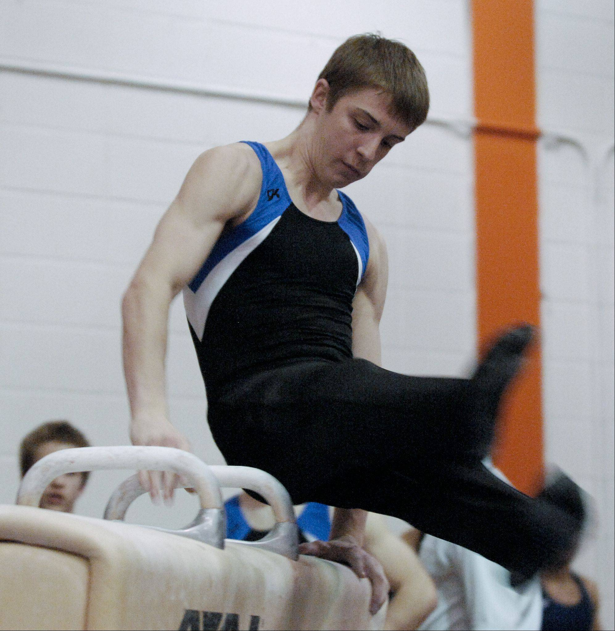 Alec Modransky of Wheaton Coop performs on the Pommel Horse during the Wheaton Warrenville South boys gymnastics sectional, Wednesday.