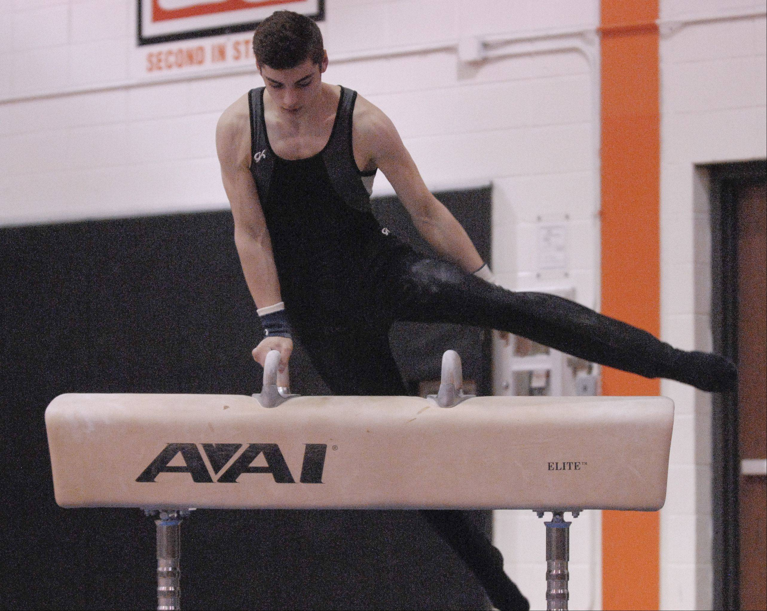 Bret Golz of Willowbrook performs on the Pommel Horse during the Wheaton Warrenville South boys gymnastics sectional, Wednesday.