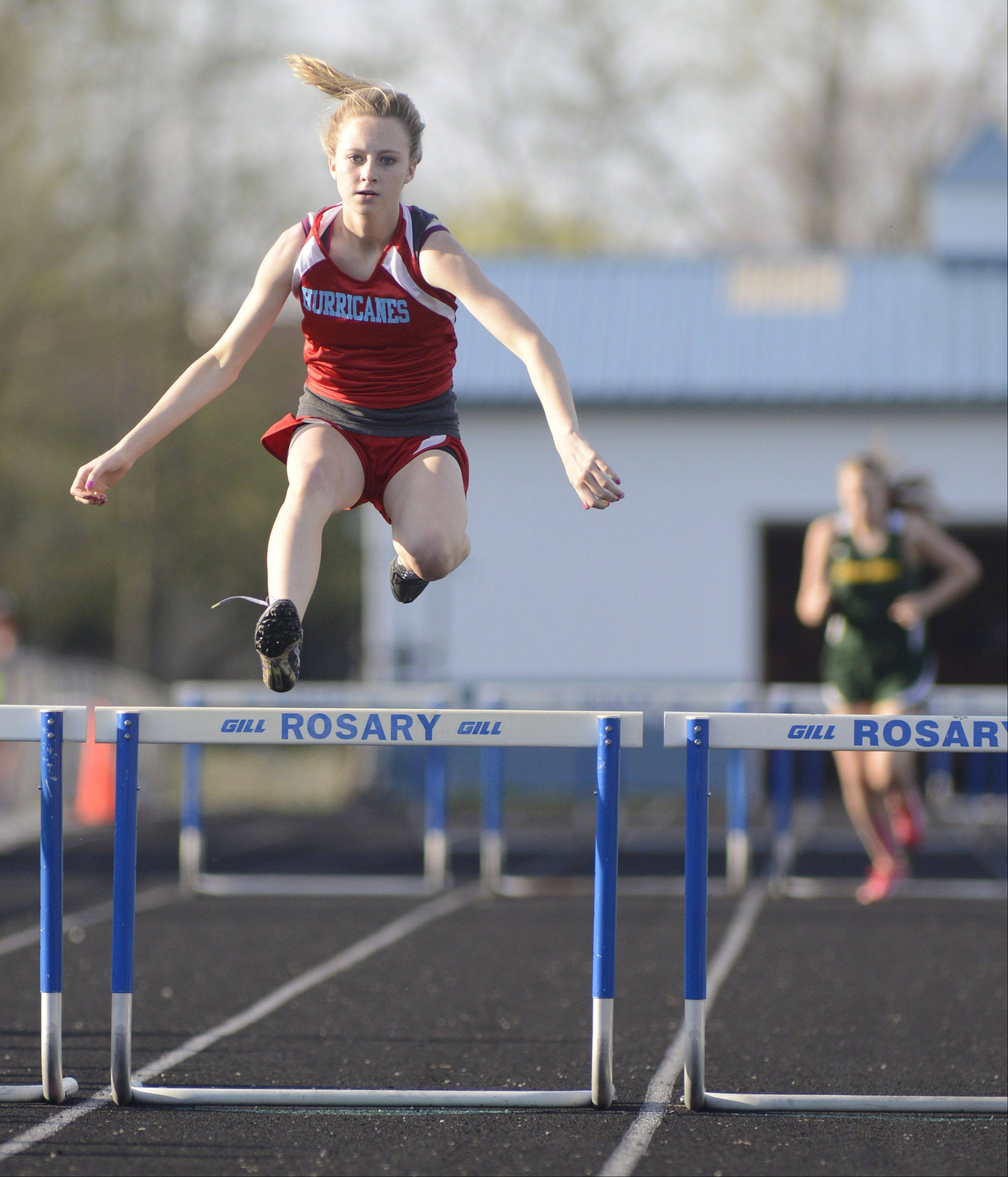 Marian Central's Rachel McNulty soars over the final hurdle in the first heat of the 300 meter hurdles at the Suburban Christian Conference on Wednesday, May 1.