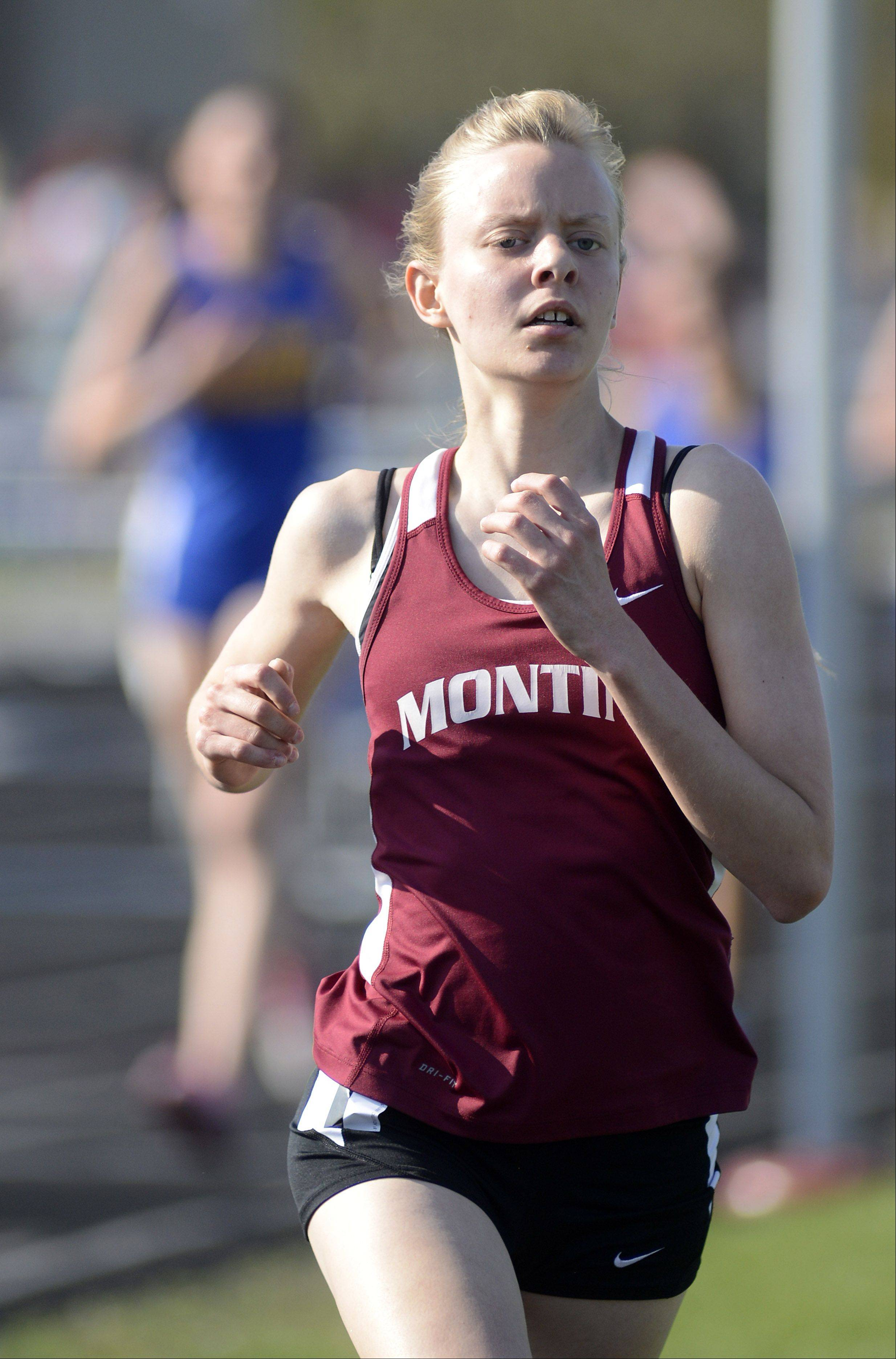 Montini's Maggie Hallerud wins the 3200 meter run at the Suburban Christian Conference on Wednesday, May 1.